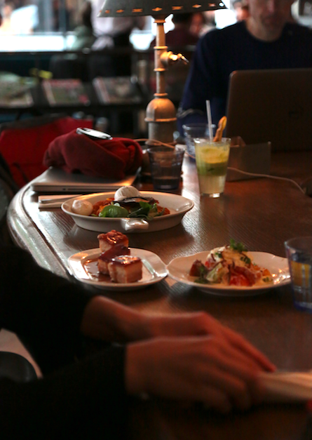 On the table: Chorizo Hash Brown, slow roasted pork belly &Heritage Tomato salad with home-made burrata.