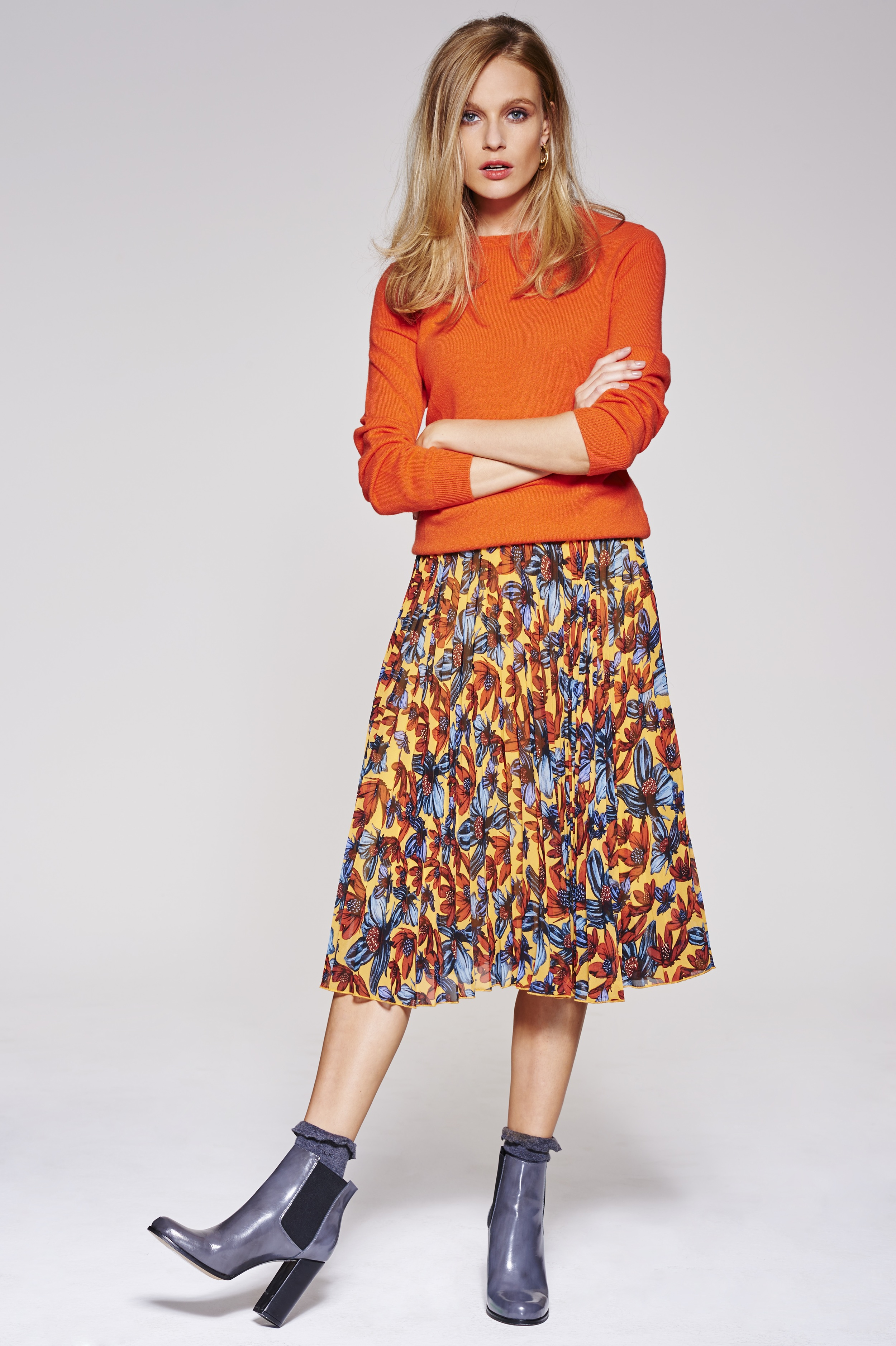 Orange cashmere jumper, £75,  M&S     Mid-length pleated floral skirt, £45,  Topshop     Grey socks, £2.99,  TK Maxx     Grey heeled ankle boots, £115,  Dune