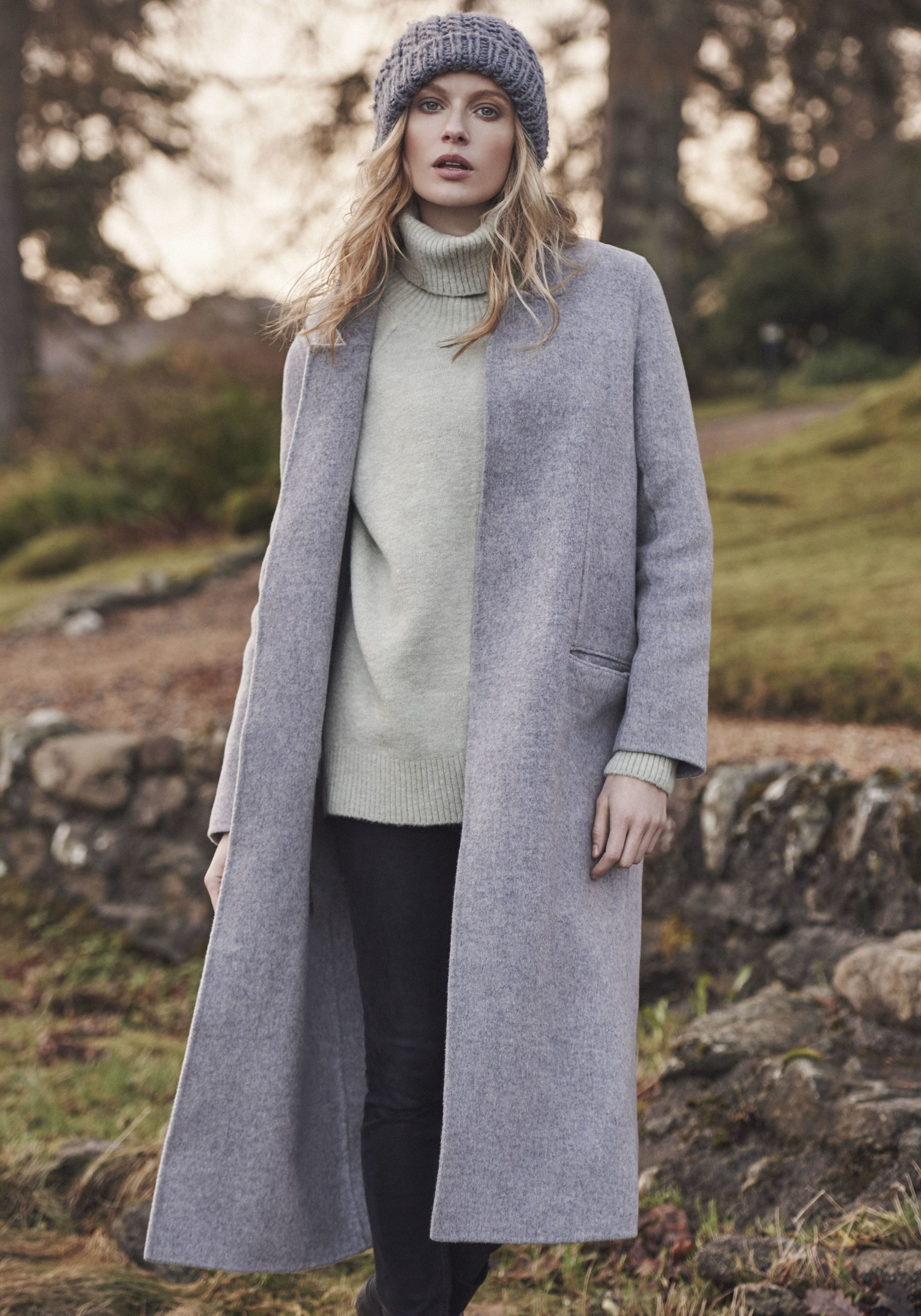 This is one of my fav images from the shoot wearing   Duster coat, £85 from Topshop ,   Wool jumper, £45 from M&S ,   Jeans, £40 from Asos and  Oversized beanie, £17, Accessorize