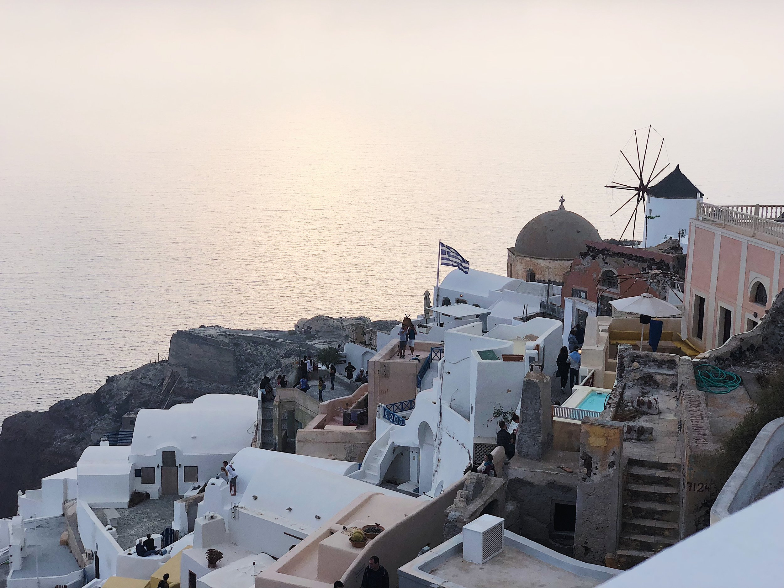 A foggy sunset seen from the Sunset Café in Oia