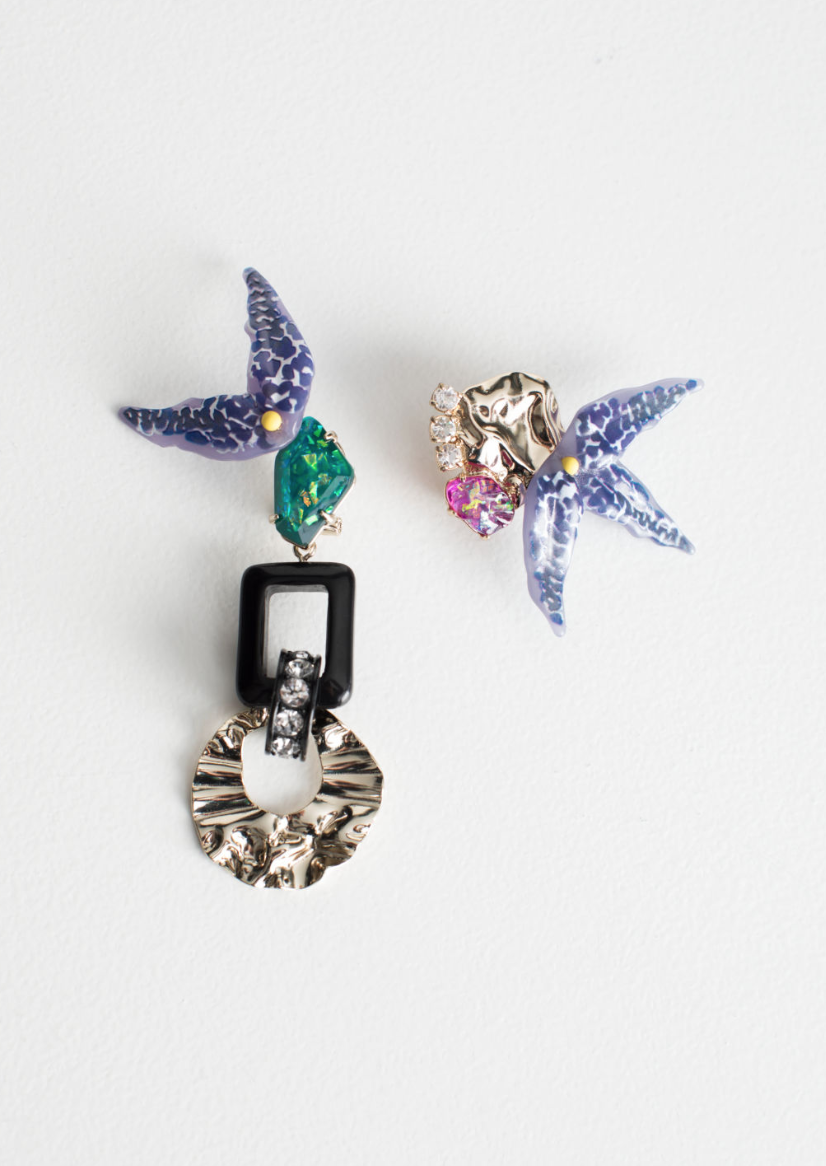 Asymmetrical Tropical Flower earrings - How cool are those? Such a great idea to have a set of asymmetrical earrings with some beautiful paradise flowers and organic chrome shapes. Find this cool number at one of my favourite shops and other stories here for £35.