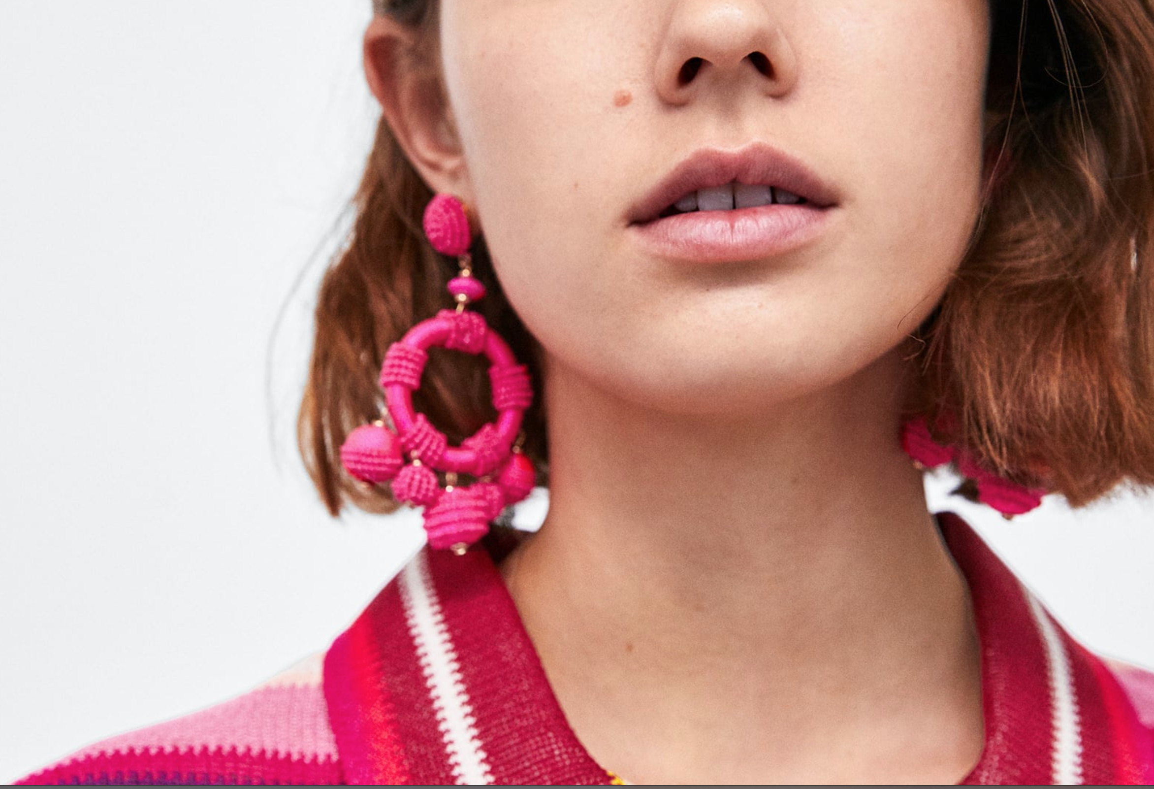Pink beaded circular earrings - These fuchsia beaded earrings make me want to go on holiday so badly. Its a pair of earrings I can imagine wearing with a floaty white summer dress while drinking some fresh Mojito by the seaside ;). Get them from Zara here for only £12.99!
