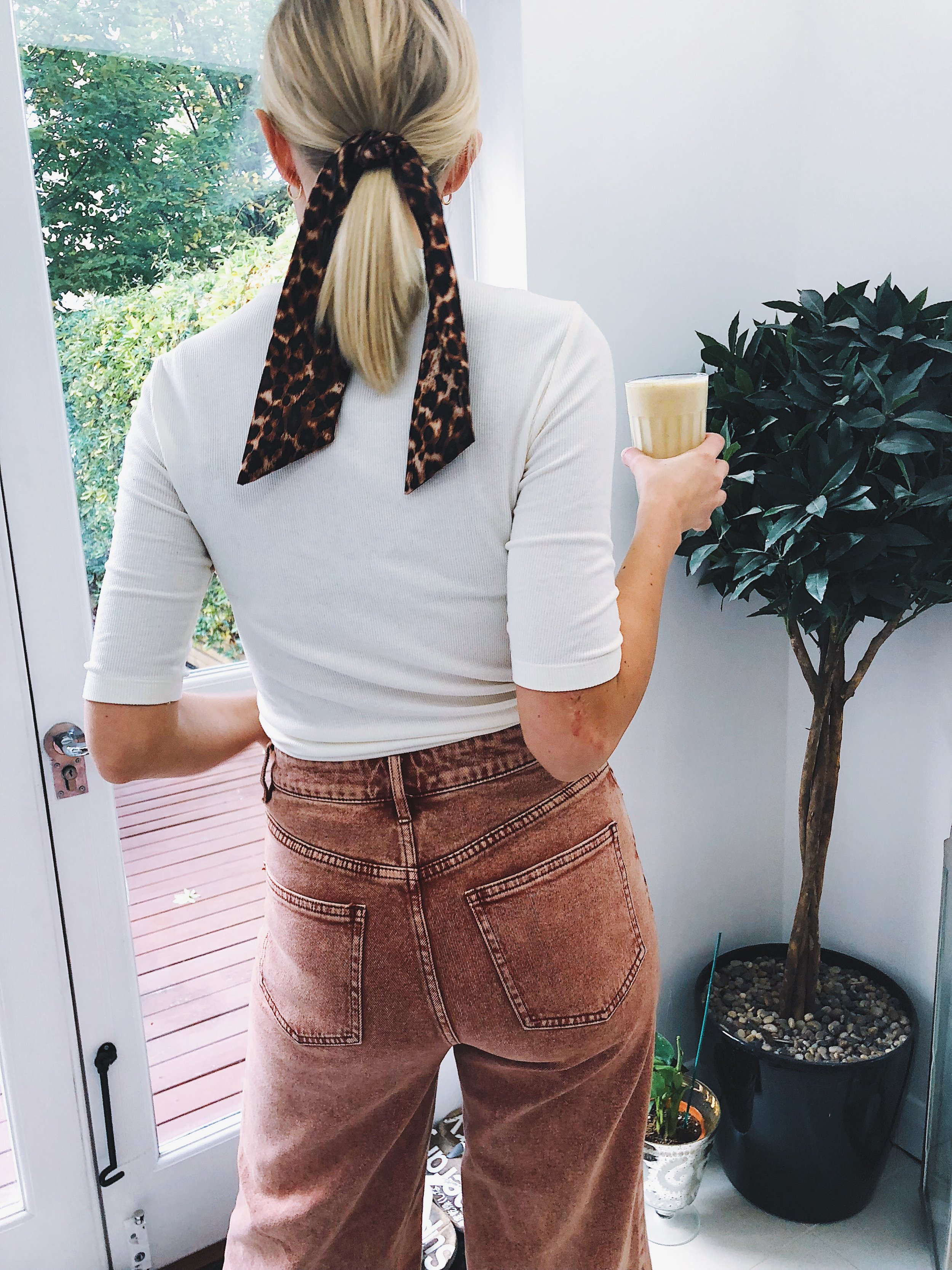 THE LOW PONY - This is one of the more standard ways of using a scarf as a hair accessory.Tie it around your low ponytail and let the ends hang down.
