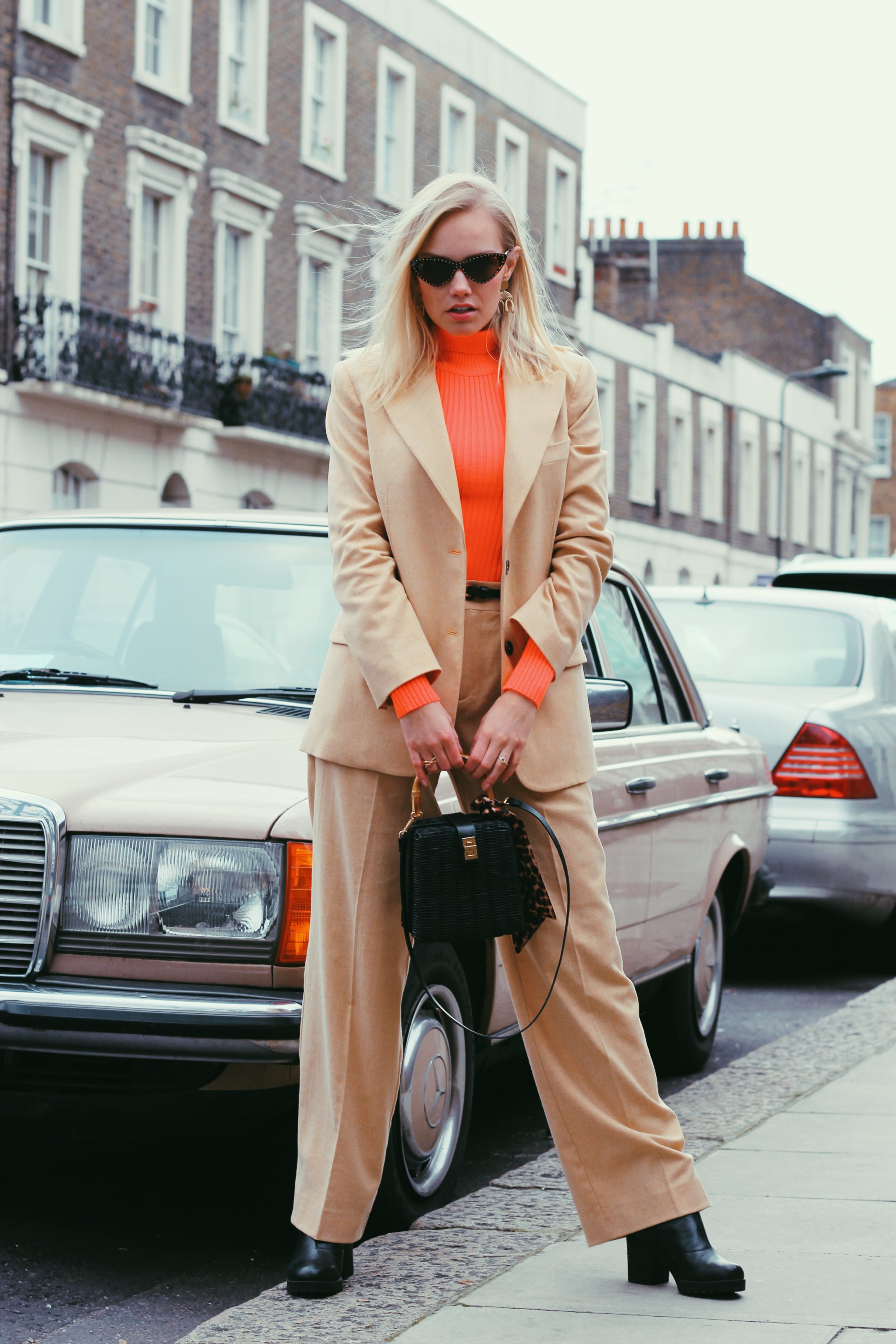 NEON - ONE OF THE BIGGEST SS19 TRENDS - We don't want to go all out rave-neon, but pairing one super bright item with a more subtle outfit (like a beige wool suit like I have gone for here) is totally doable!Neon colours make me think of summer and it looks like we will be seeing way more off it in the upcoming Spring/Summer collections.Soon (but not quite yet) we can say bye-bye to big chunky coats and scarfs, and in the meantime, we need to find a good compromise between welcoming the spring trends but also keep warm during these cold winter months. As this suit from Mango is made out of wool, it kept me nice and warm and combined with a bright neon high neck jumper, it became the perfect 'looking forward to spring, but it's still very much winter' kind of outfit :PSOMETHING OLD, SOMETHING NEWI love it when you can mix in some of your older pieces into your outfit. For this look, all the accessories I used are items I have had for quite some time and are probably not in the store anymore. However, most of the items are brand new and you can find them in the shop slightly further down in this post.