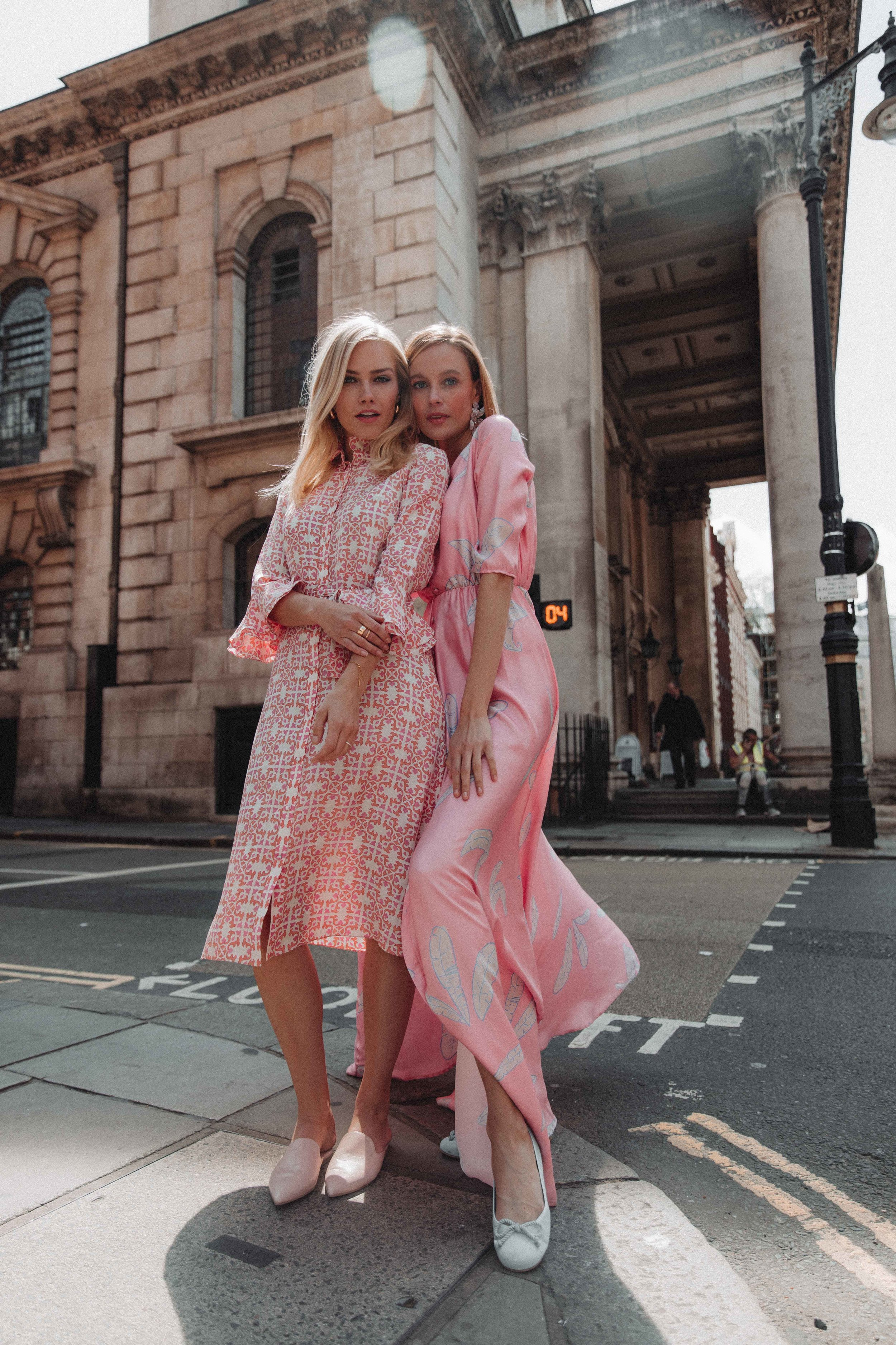 Pink dresses - Summer street style. Photo by: Lydia Collins