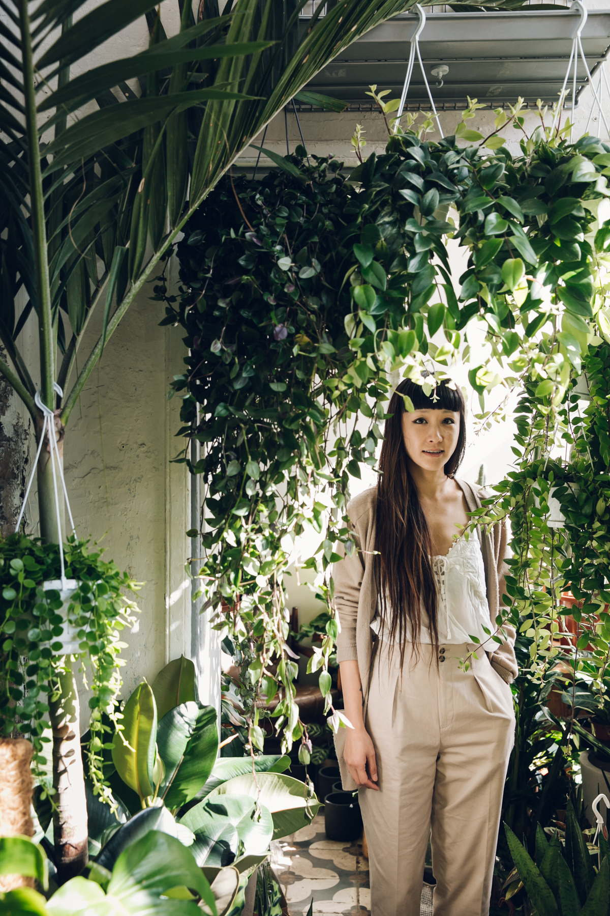 Horticulturist Jin Ahn amongst the plants in her shop, Conservatory Archives.