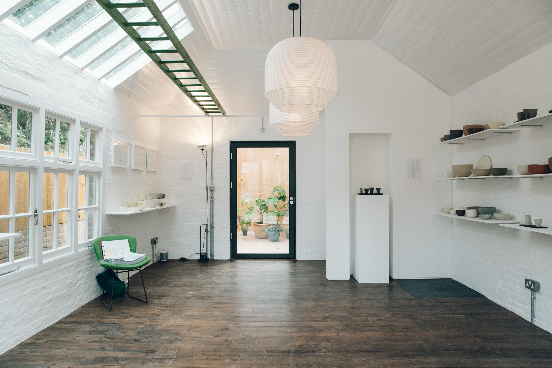 Light and airy gallery space in a converted garage.