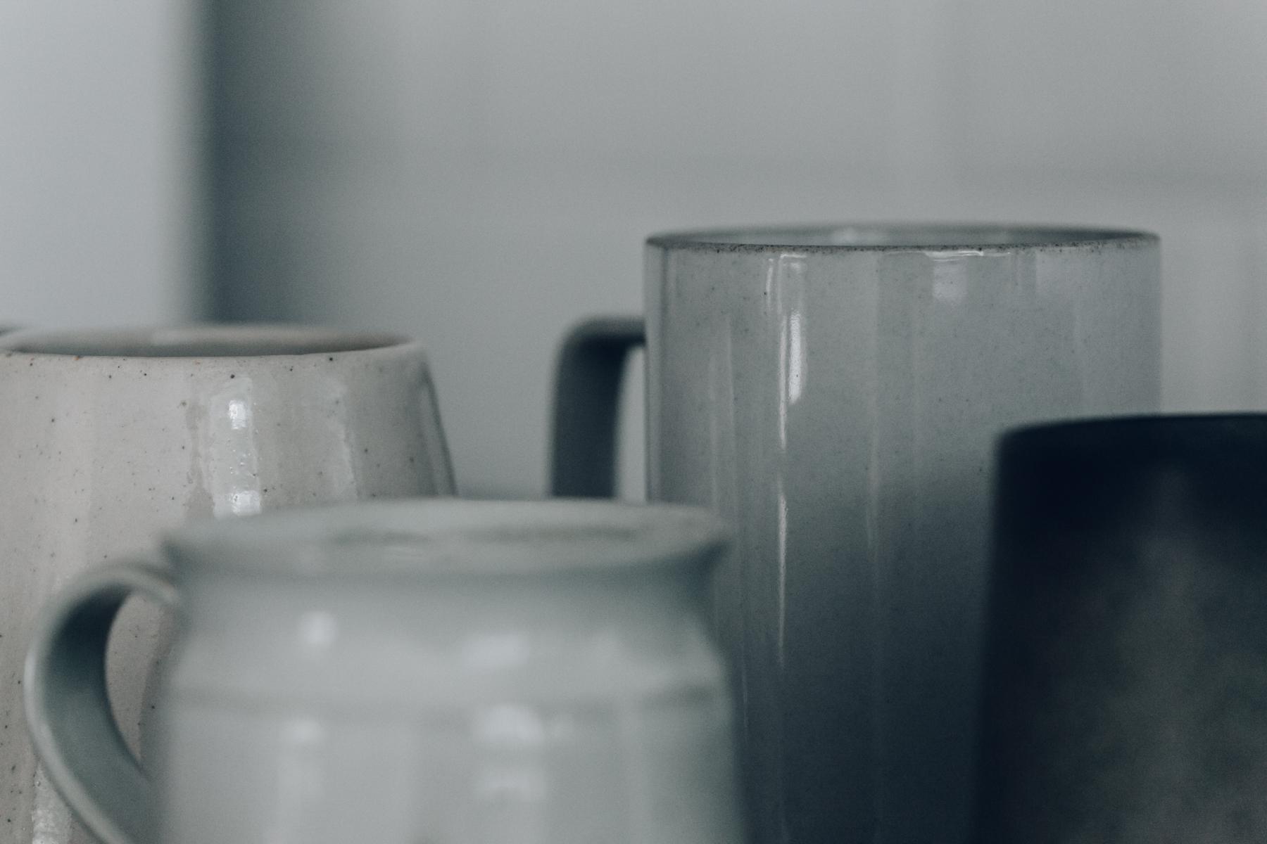 Close-up details of our ceramic mug collection.