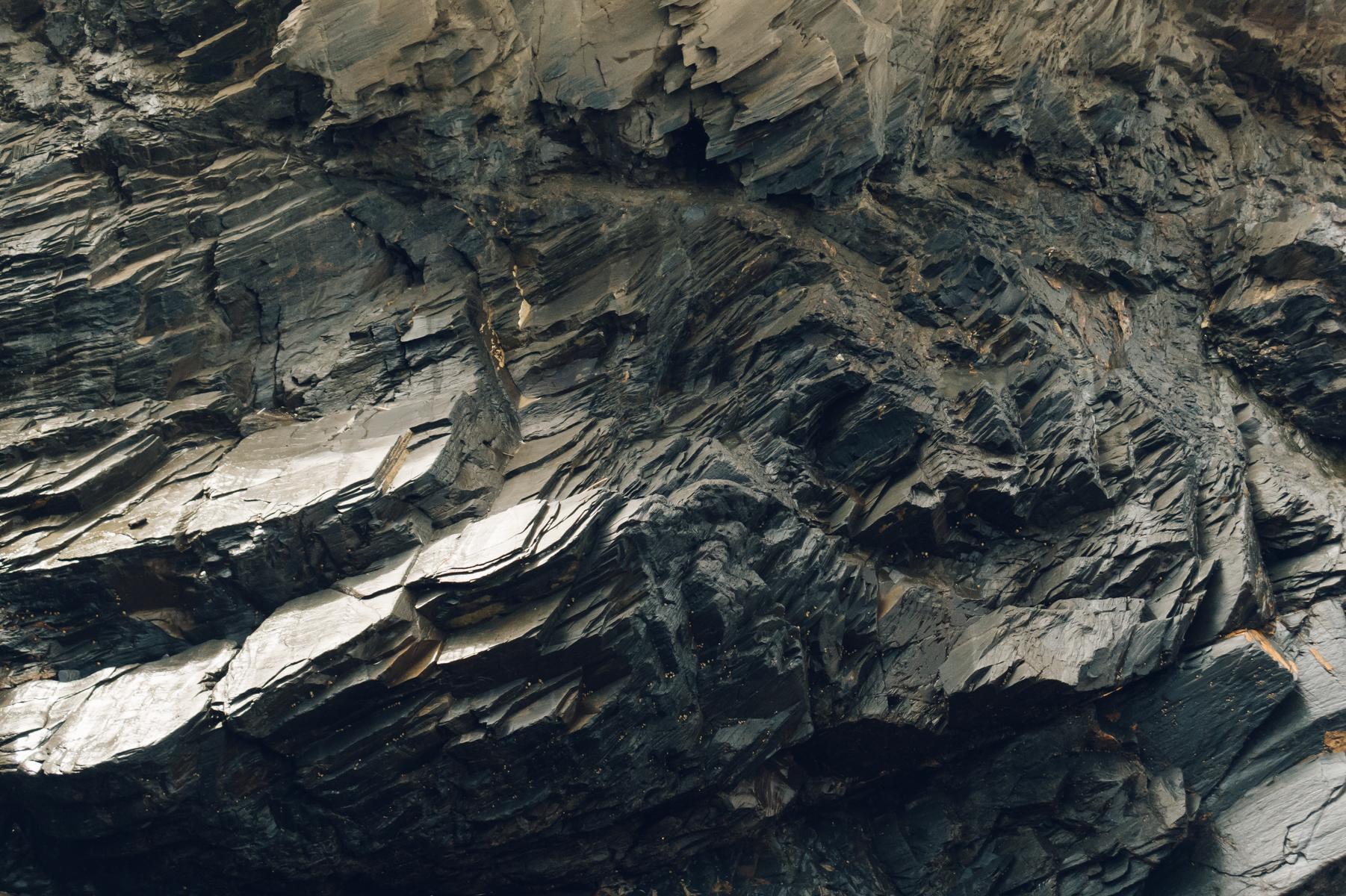 Dark rockface.