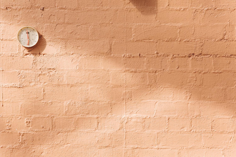 Peachy pink wall.