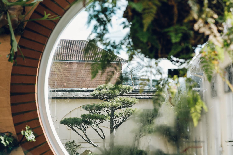 Incredible garden views through a porthole window.