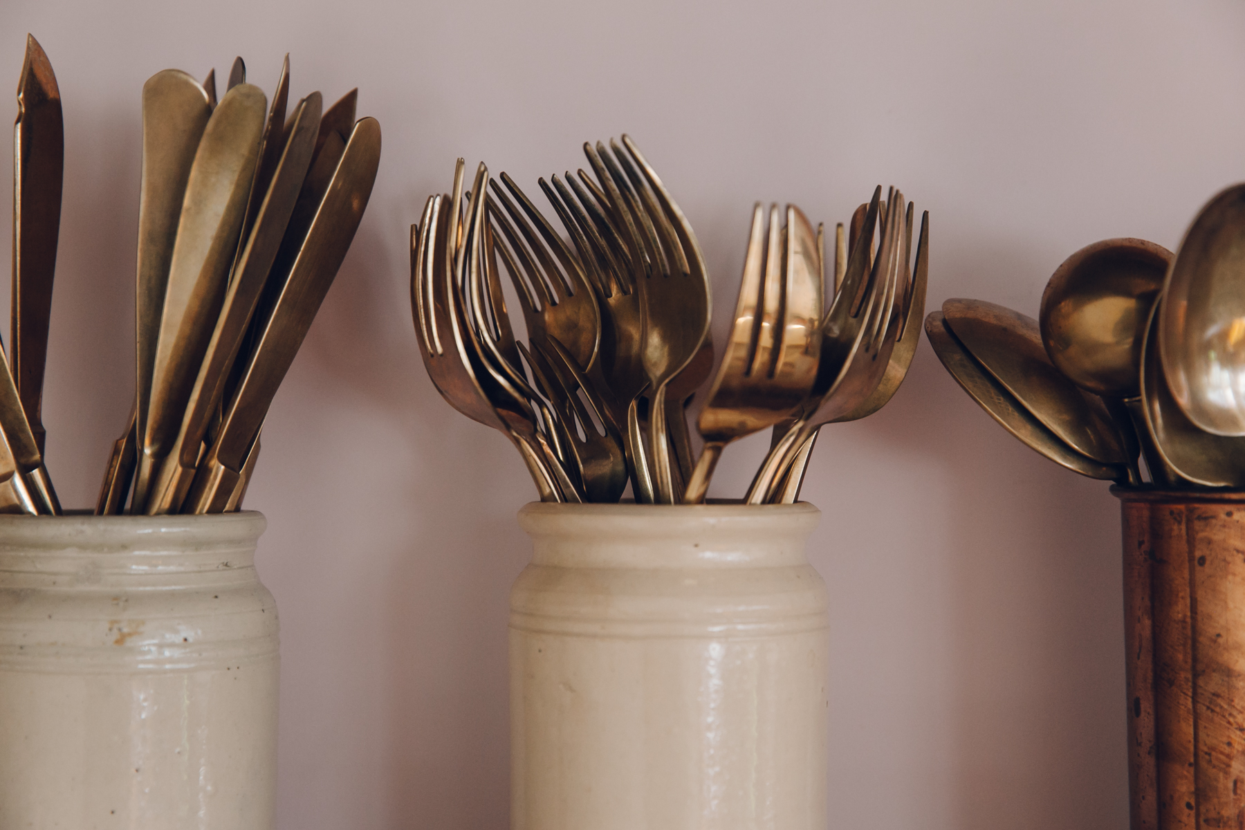 Brass and gold kitchen utensils and cutlery.