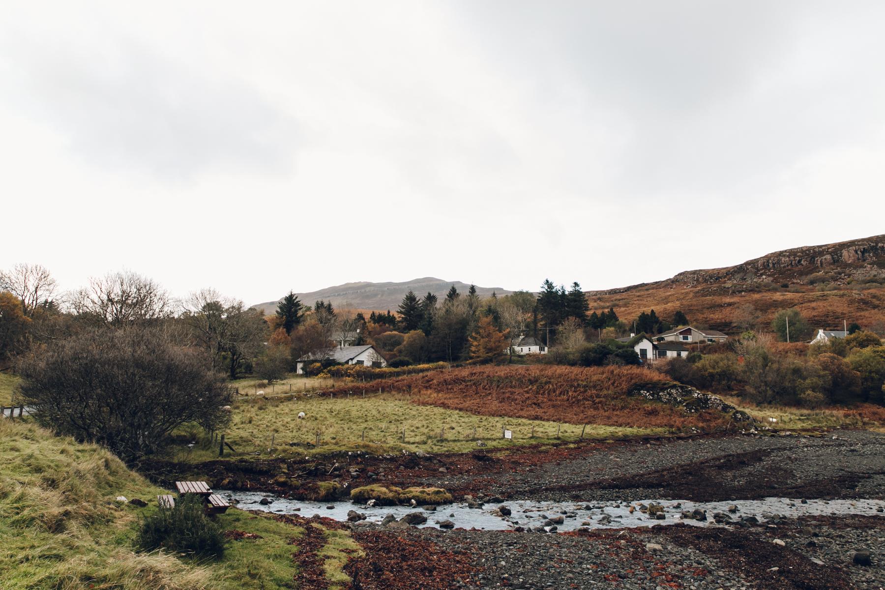 Houses overlooking Camustianavaig Bay on the Isle of Skye in Scotland.