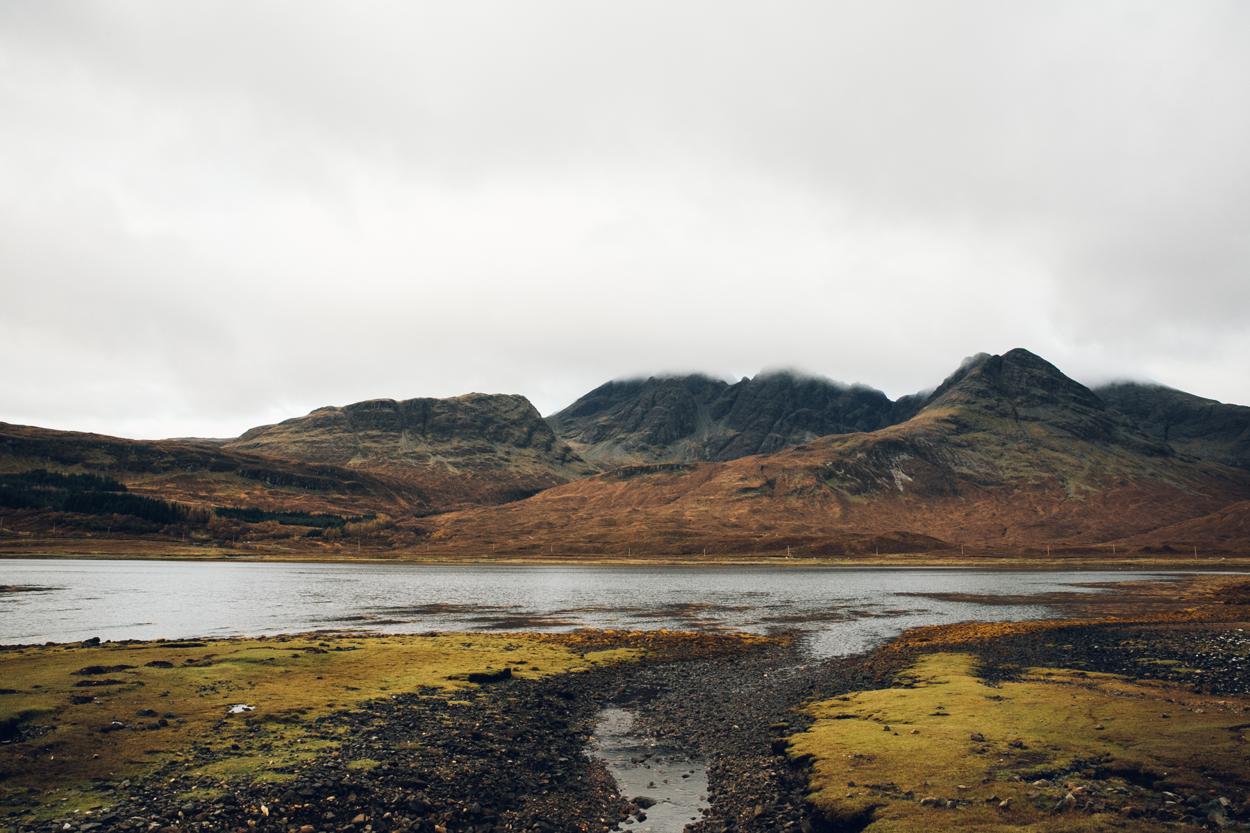 Misty mountains across the water on the Isle of Skye in Scotland.