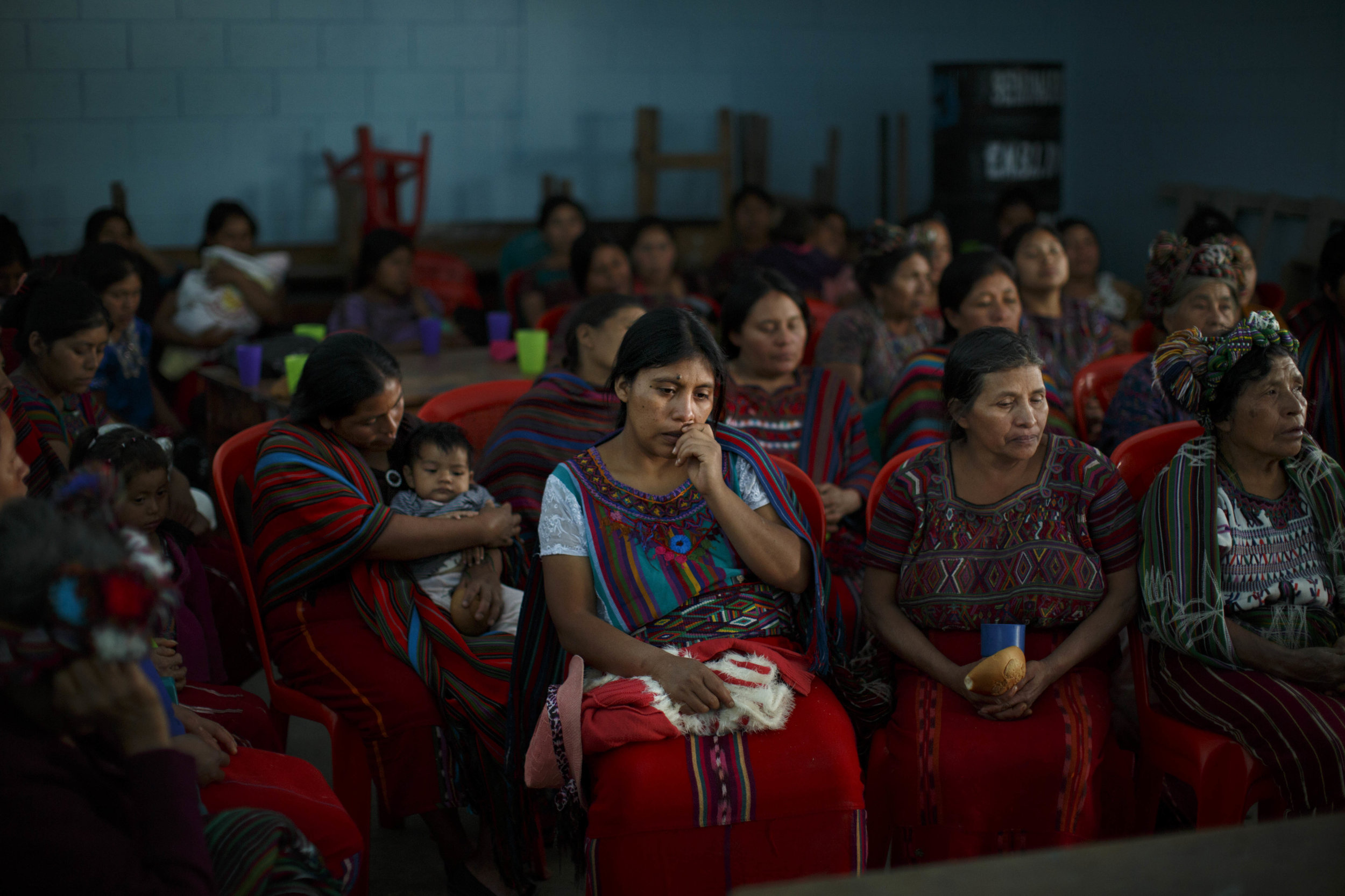 Commissioned for World Health Day 2018 to document increased access to health care in the predominantly rural and indigenous region of Quiché, Guatemala. Photos were featured in a public campaign across public transport stations in Guatemala City.  Photo:  Women in the village of Quiché, Guatemala listen to a talk on maternal health, child nutrition, family planning and domestic violence.