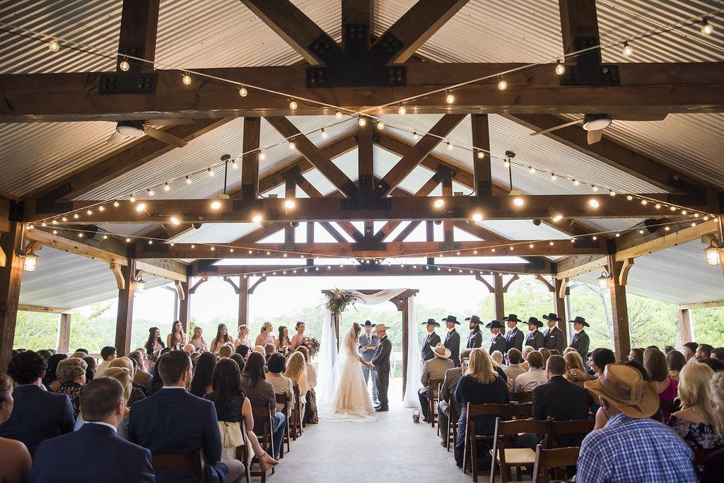 Pavilion ceremony peach creek ranch indoor outdoor barn venue