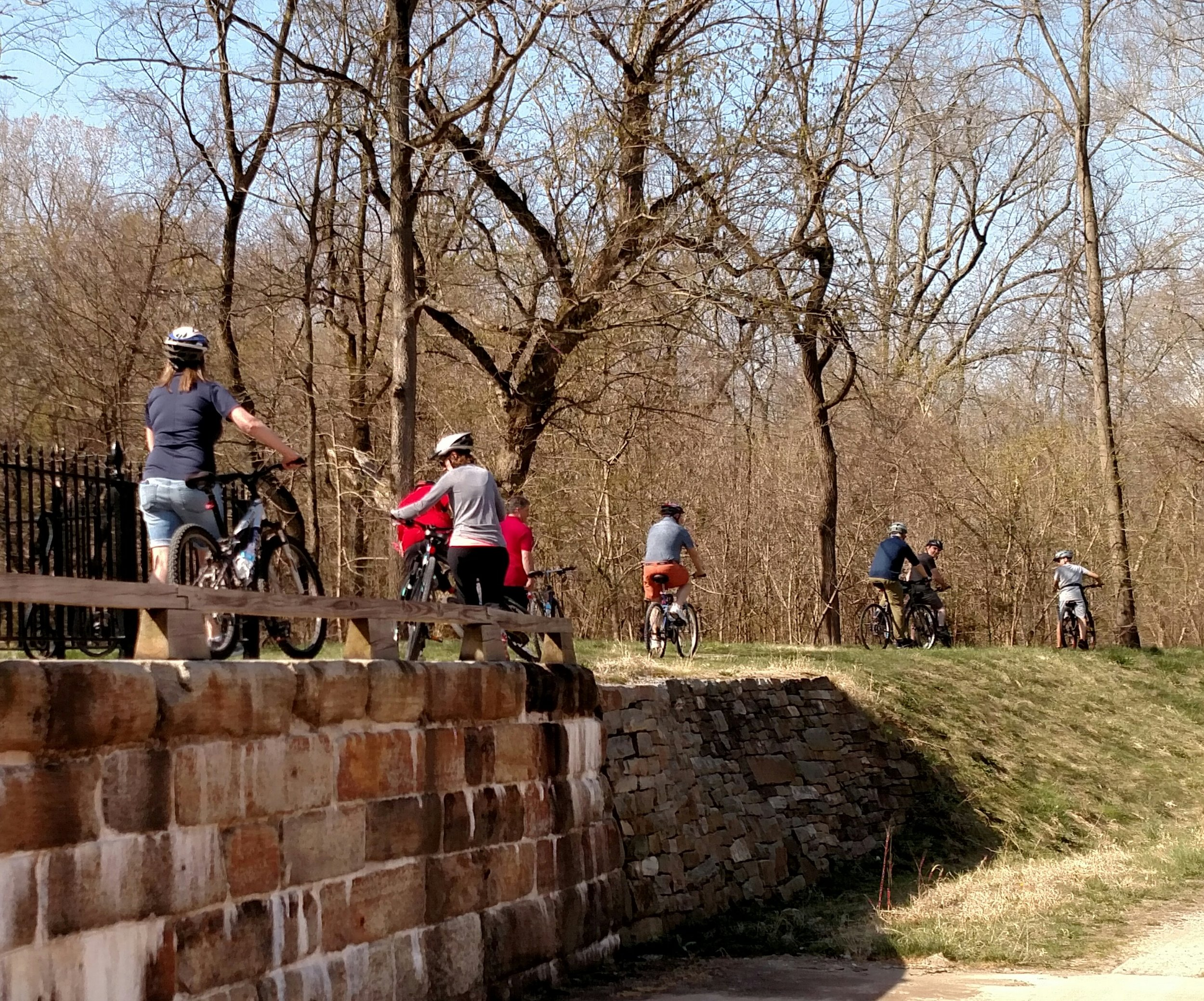 Riders cross the Catoctin Aqueduct on our C&O Canal in the Civil War bike tour.