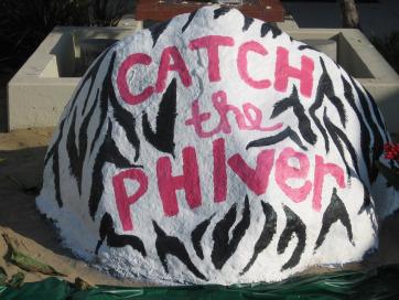 One of Pepperdine's sororities paints the campus rock.