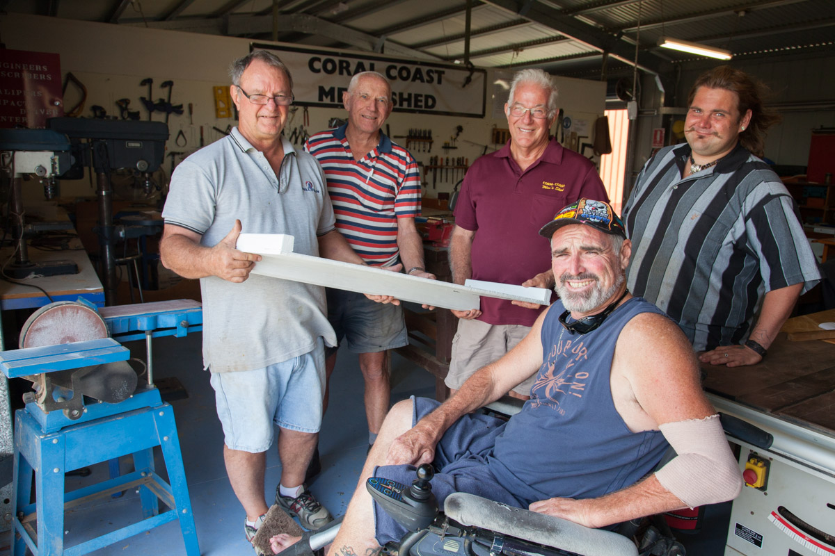 Thehandsome crew at Coral Coast Men's Shed with the little ramp - undercoat completed - for the Bargara Post Office.
