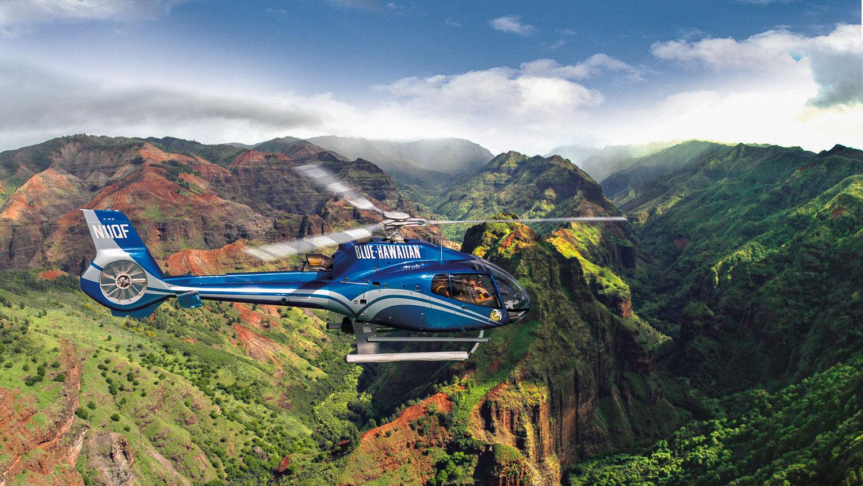 A Blue Hawaiian Helicopter tour passing over Kauai's Waimea Canyon. Photo credit  @Blue Hawaiian