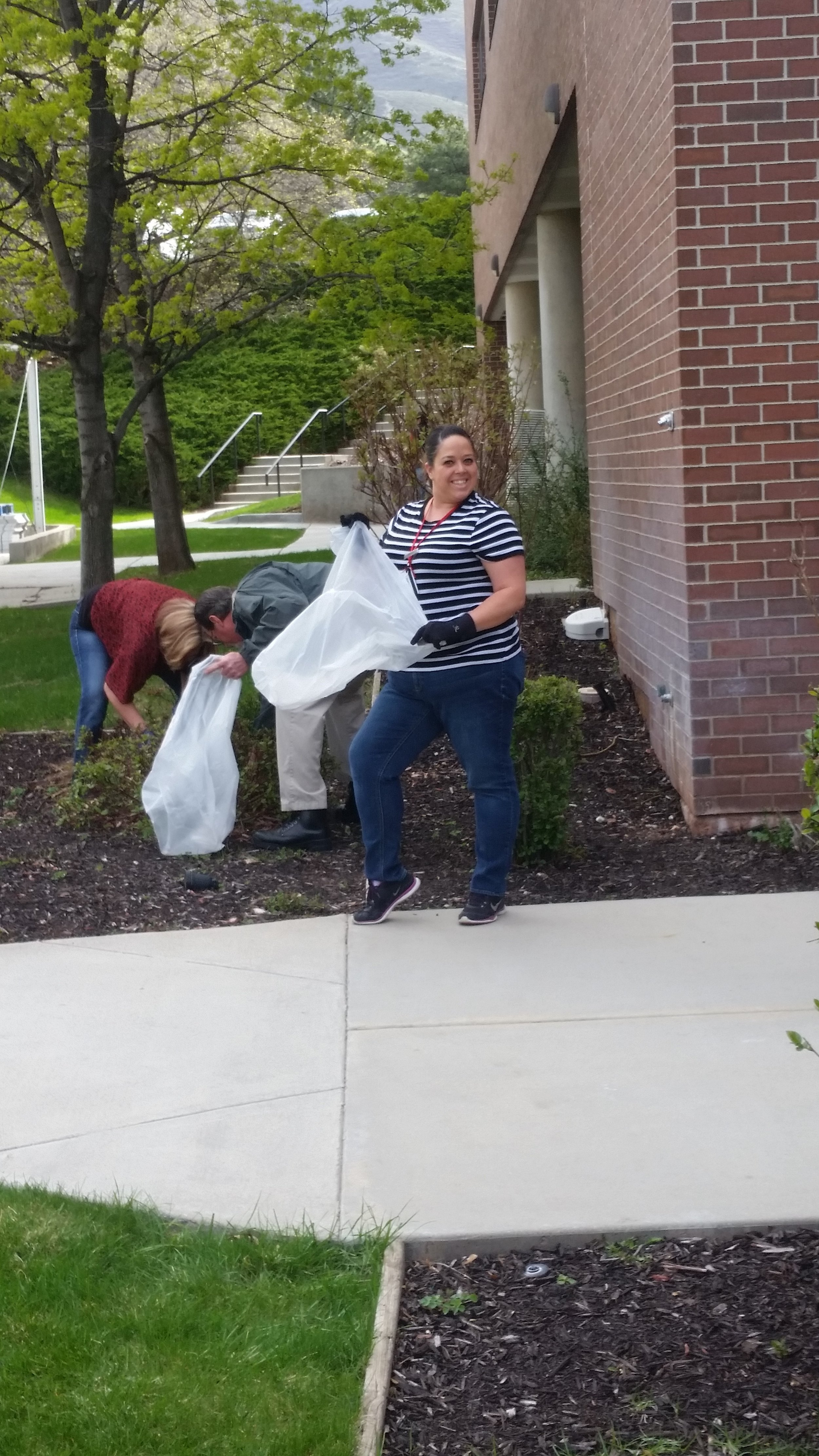 Housekeeping manager Jessica helping clean up trash on earth day.