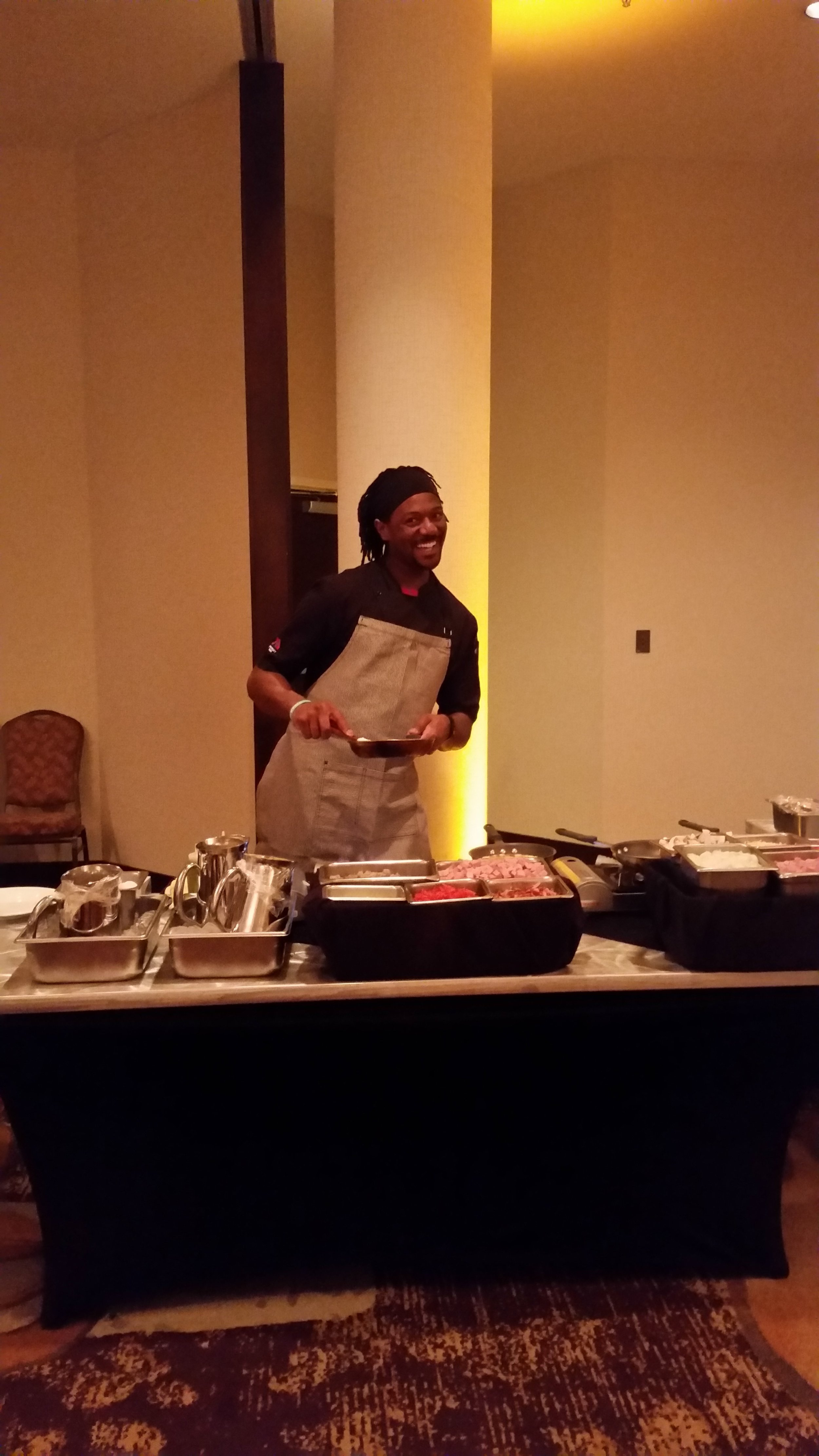 TJ having fun working the omlet station.