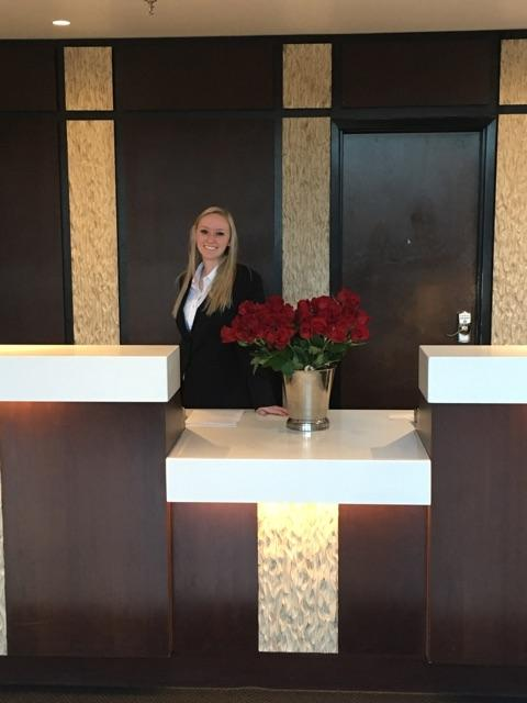 Front desk agent Hadli getting ready to hand out flowers for Mother's day.