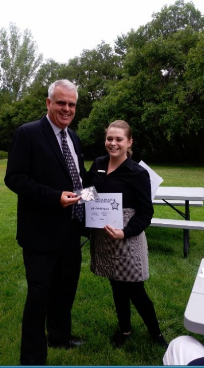 Allie's server Katie getting her employee of the month award from General Manager Steve Dennis.