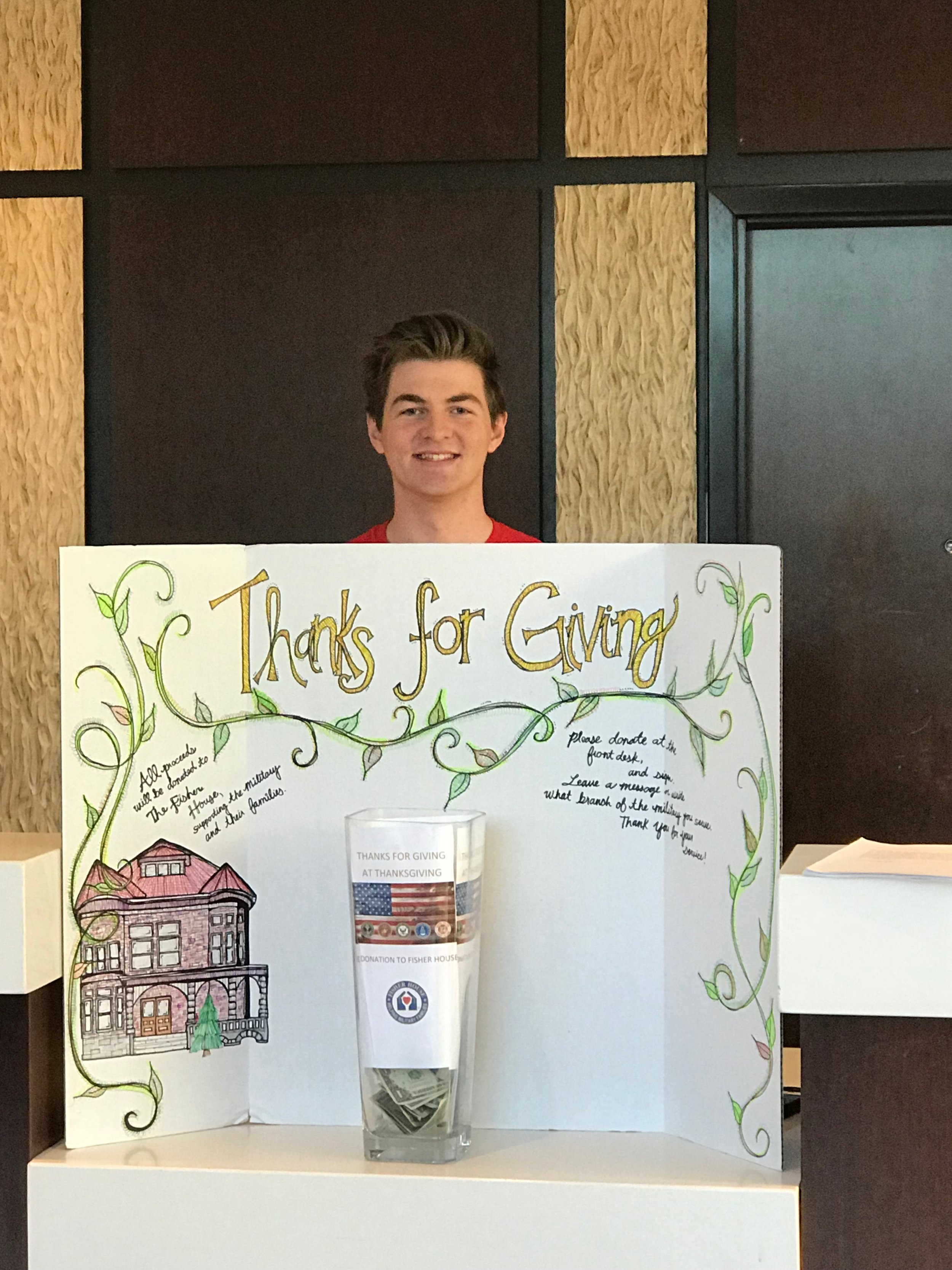 Front desk agent Lyle posing for a picture with our poster for Thanks For Giving. All proceeds will go to the Fisher House in Salt Lake City for veterans.