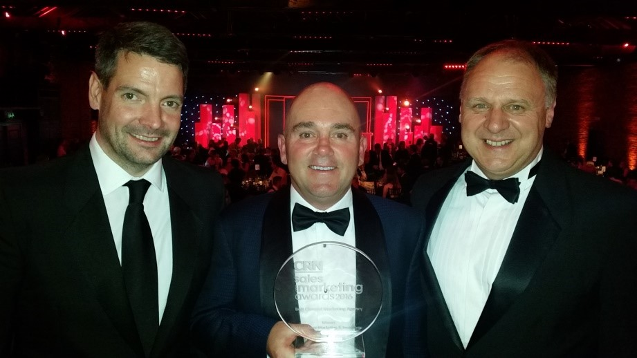 L to R: Commercial Director - Richard Merry, CEO - Dr David Cox, COO - Mark McKenzie collect the prestigious CRN award for Best Channel Marketing Agency