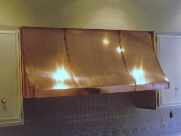 Custom Brass enclosures for above your stove.