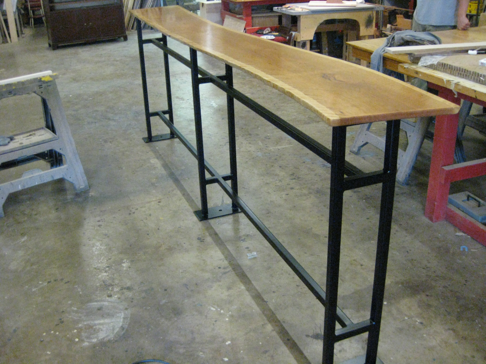 We have literally crafted tons of unique tables and table bases.  Here is an example for Starbucks.