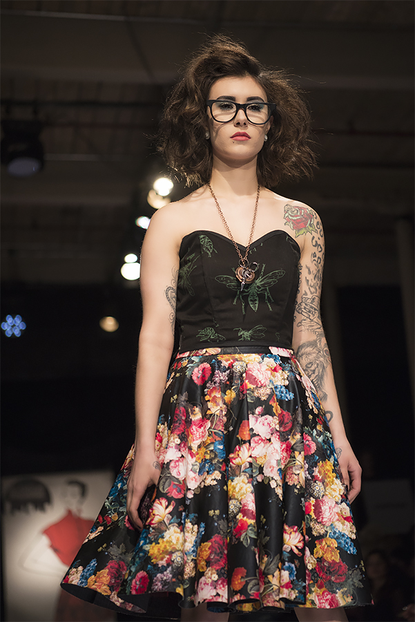 Kaylaa wears freshly picked flowers from a midnight garden and a bustier with original silkscreened art by Bryce Huffman. Photo by Andy Burleigh, glasses courtesy of Advanced Vision.