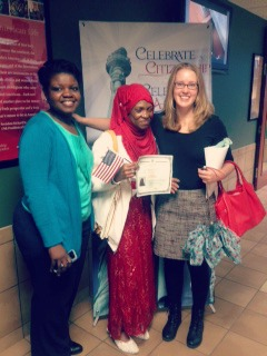 aimee zangandou from LSG's Refugee Services Department and ashley lariccia from LSG's Immigration department pose with monica Sherrif at her naturalization ceremony