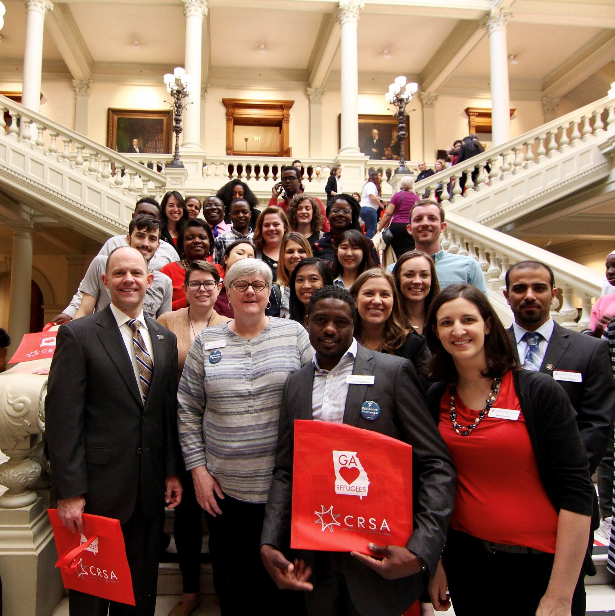John with our refugee services staff and volunteers at the Capitol