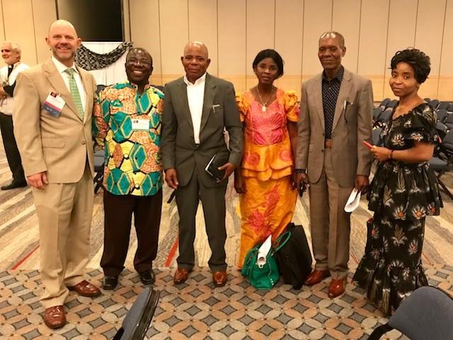 Crispin with members of good samaritan ministry and John Moeller, CEO, LSG.