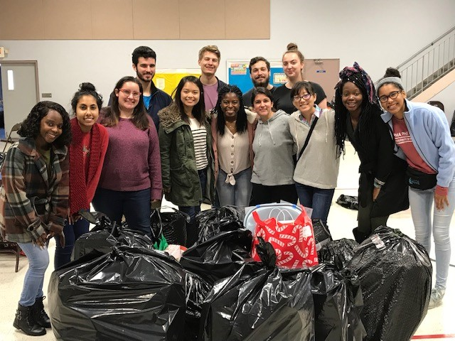 University of Florida students help sort and deliver hundreds of gifts for Inspiritus families