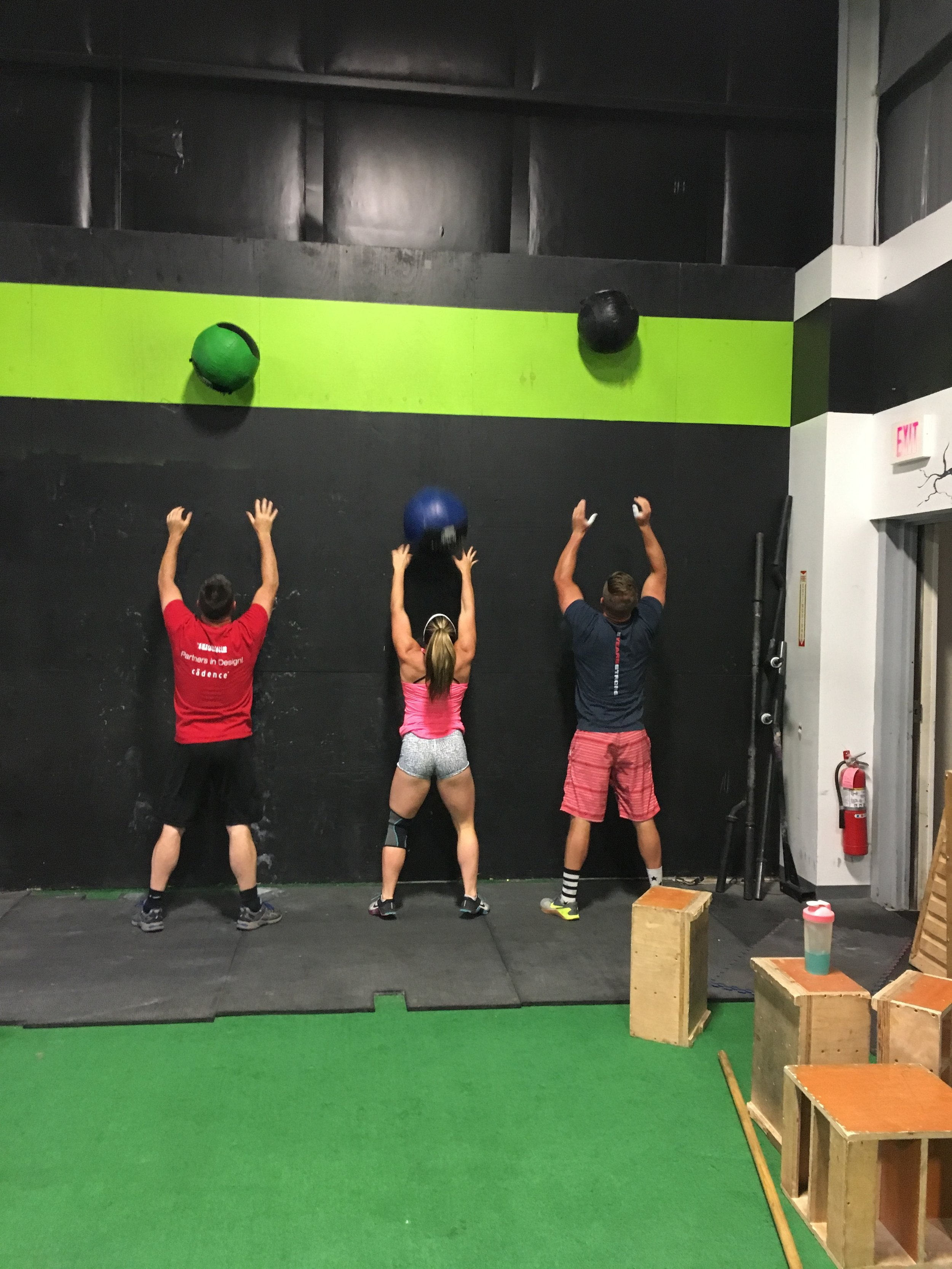 Three McGrath's slinging Wall Balls! ;)