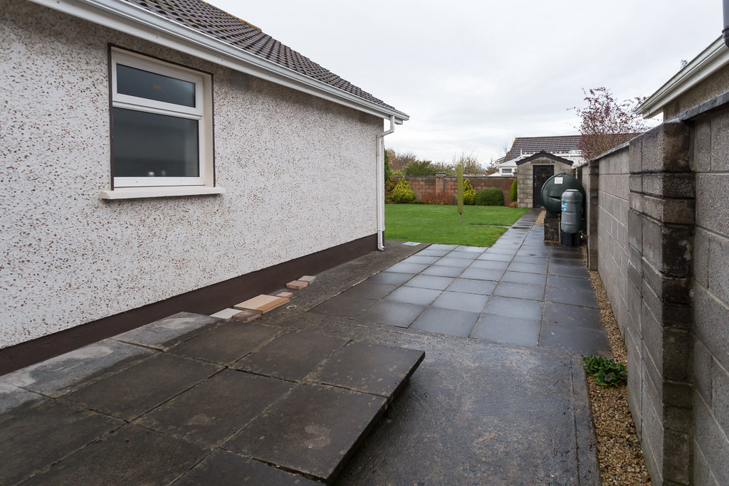 The raised rear patio area was to be removed and the step taken away.