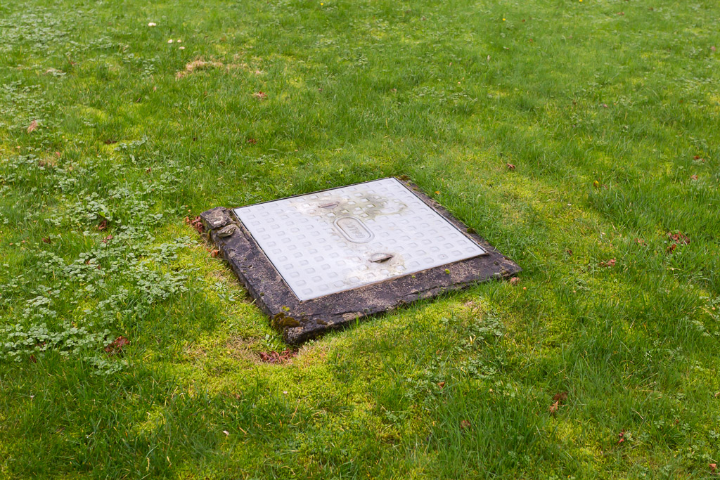 The manhole cover on the lawn was unsightly, I suggested a manhole installation that would remain hidden yet still be fully functional if access was ever required.