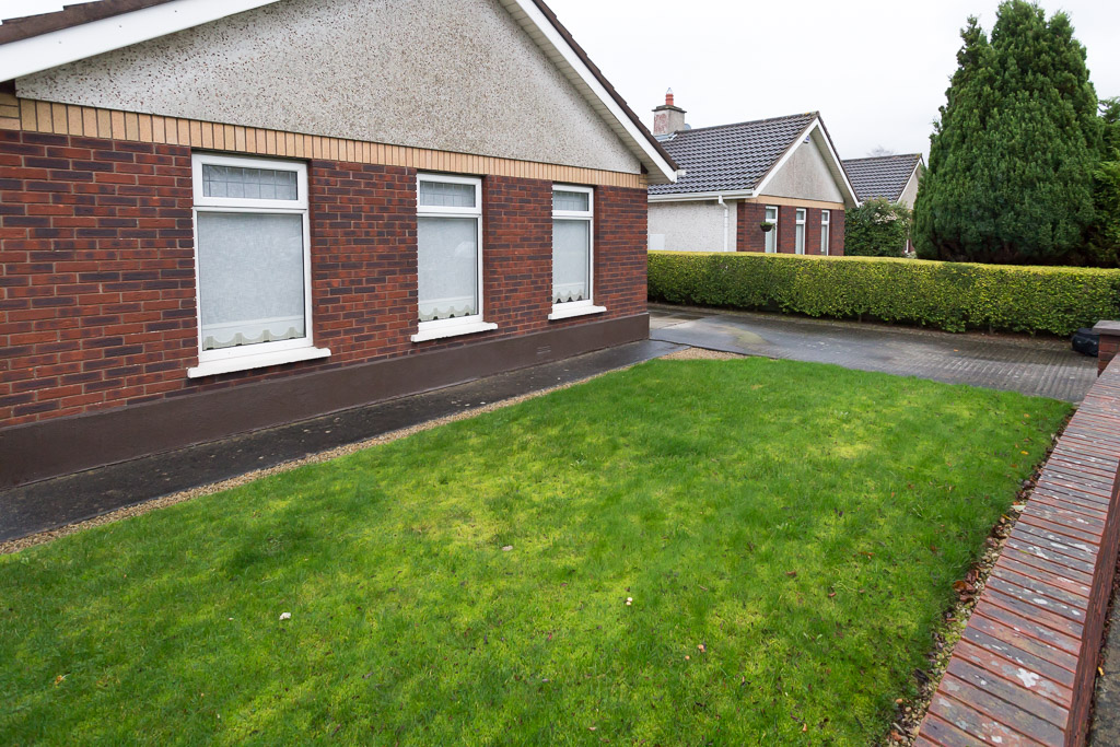 The client wished to have the front area paved to reduce maintenance.