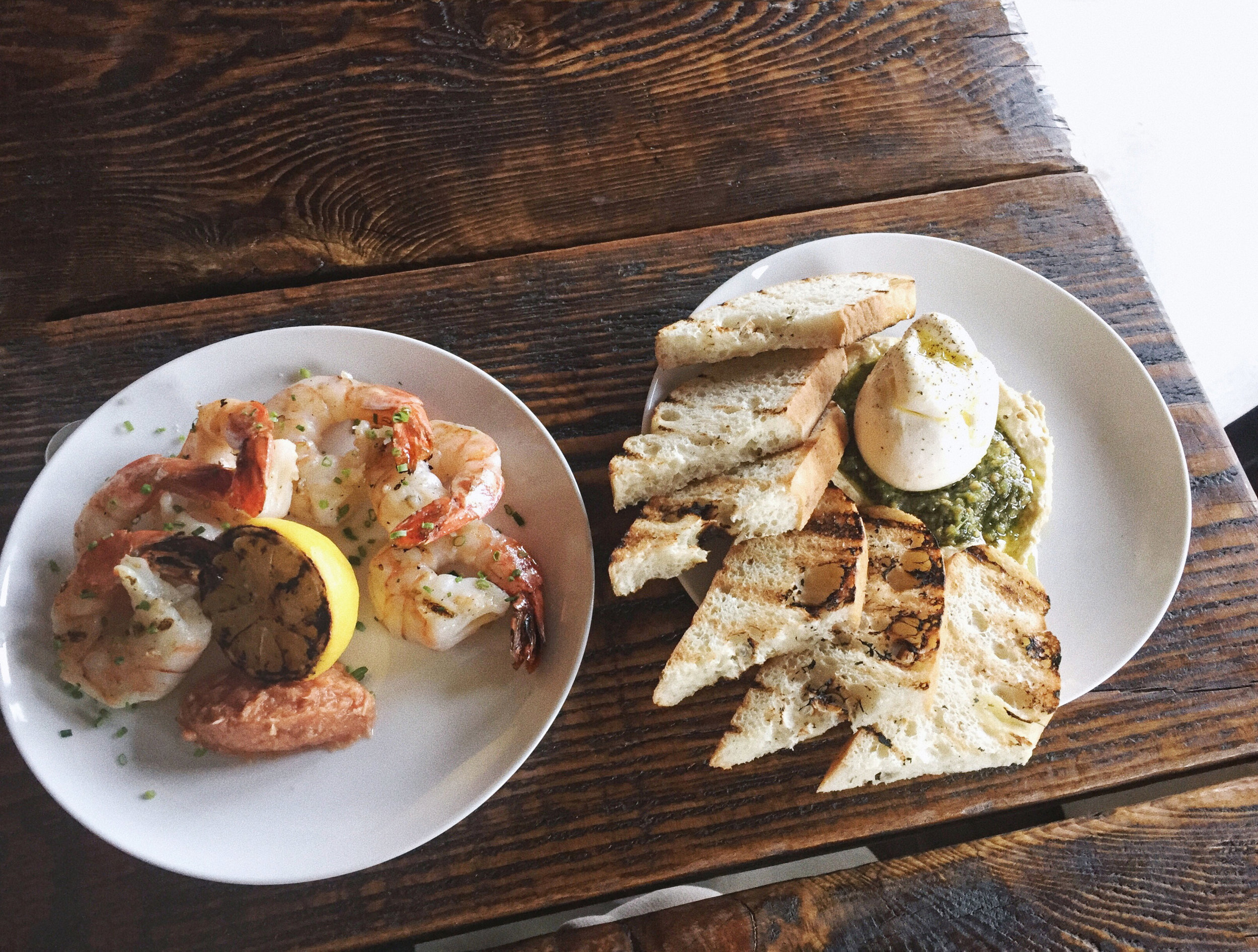 Boxcar Social | Grilled jumbo shrimp, garlic butter, cocktail sauce, lemon & local burrata, chickpea hummus, walnut pesto with grilled rosemary focaccia.
