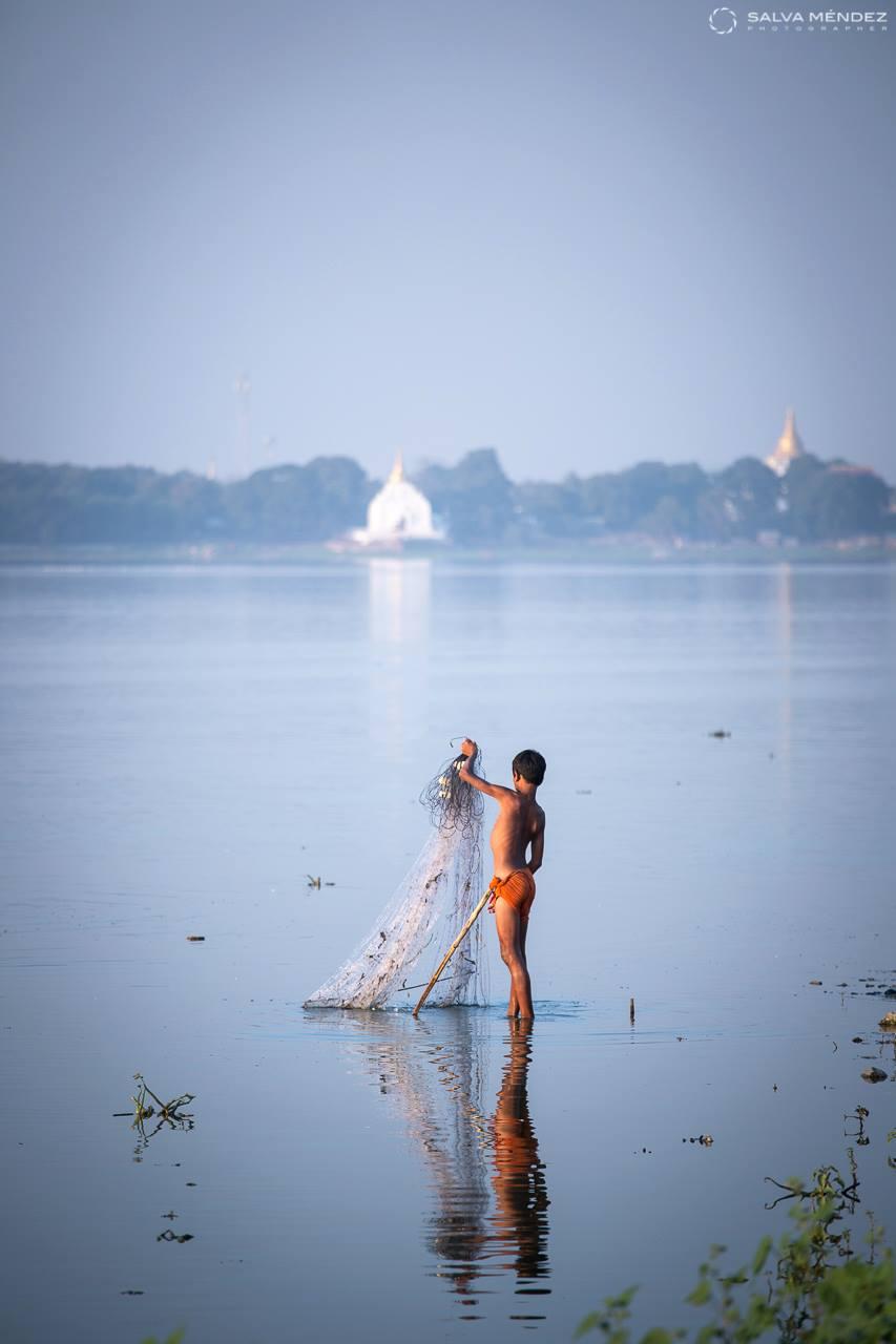 Fisherboy at Taungthaman Lake, Amarapura, Myanmar.