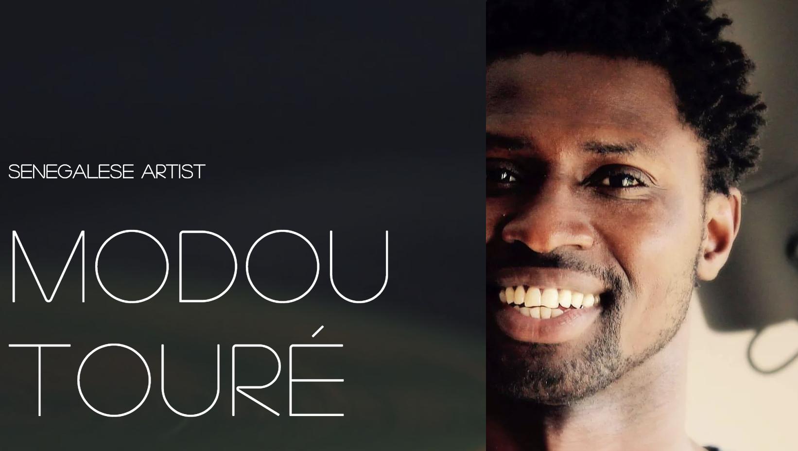 Modou Toure Headshot.png
