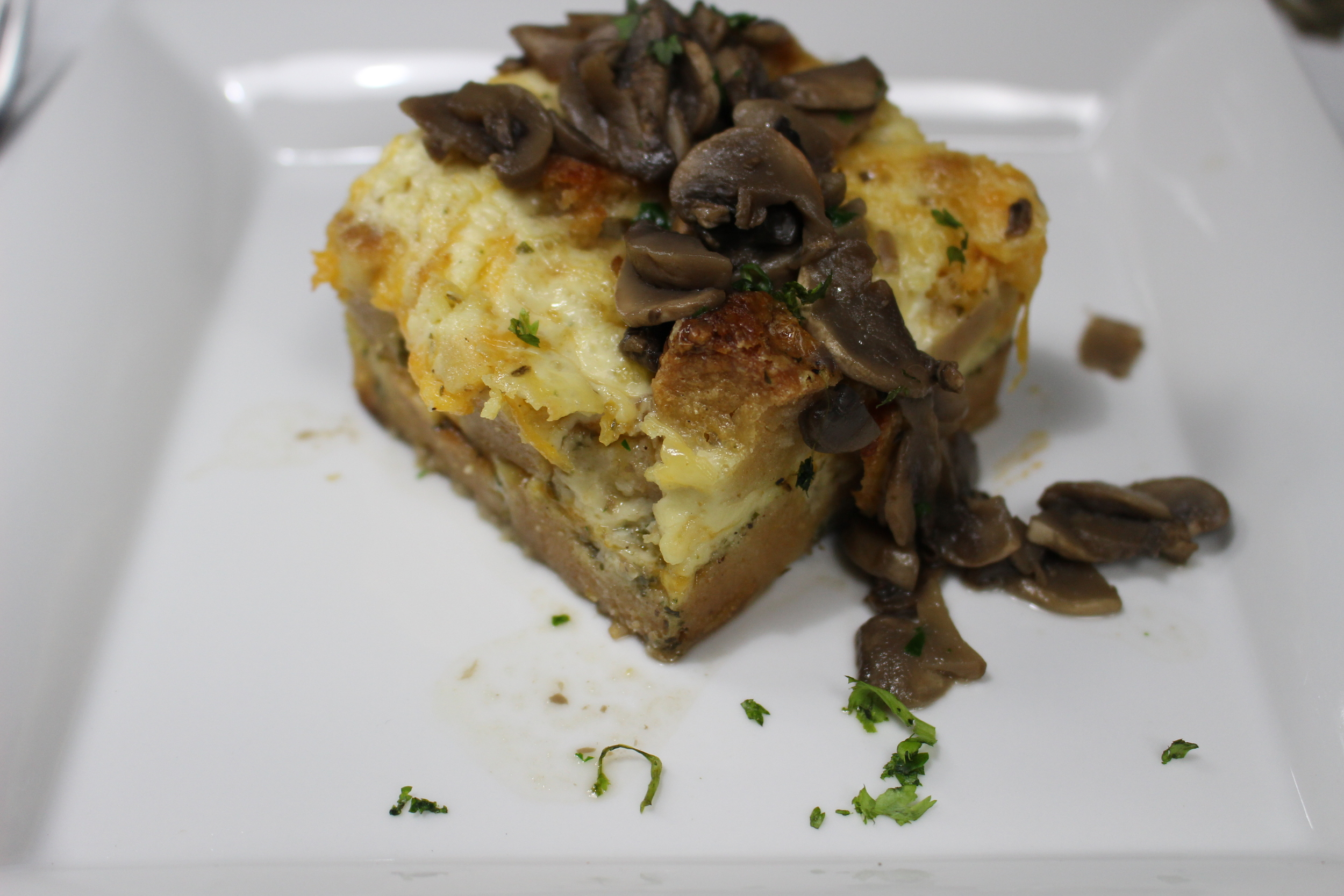 Corn Bread Pudding with Sauteed Mushrooms or Peppered Chicken Gizzard with rum mashed plantain midunu
