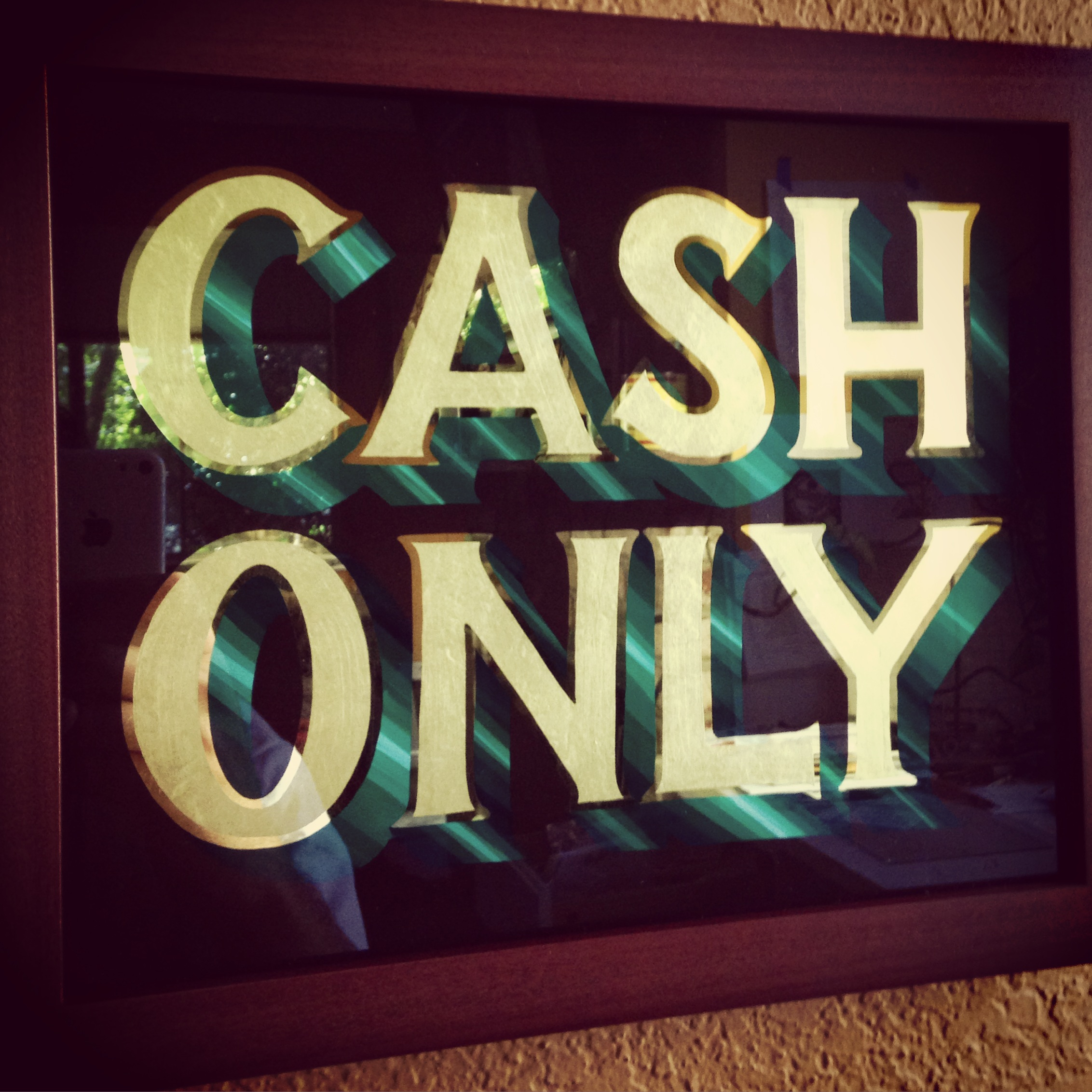 Gilded cash only sign for Paul and Eddies Monta Vista Inn of Cupertino.