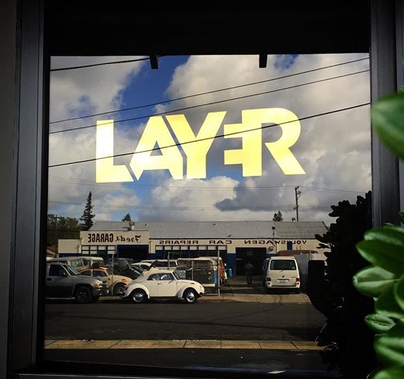 Water gilded gold leaf sign for Layer Media in Redwood City California.