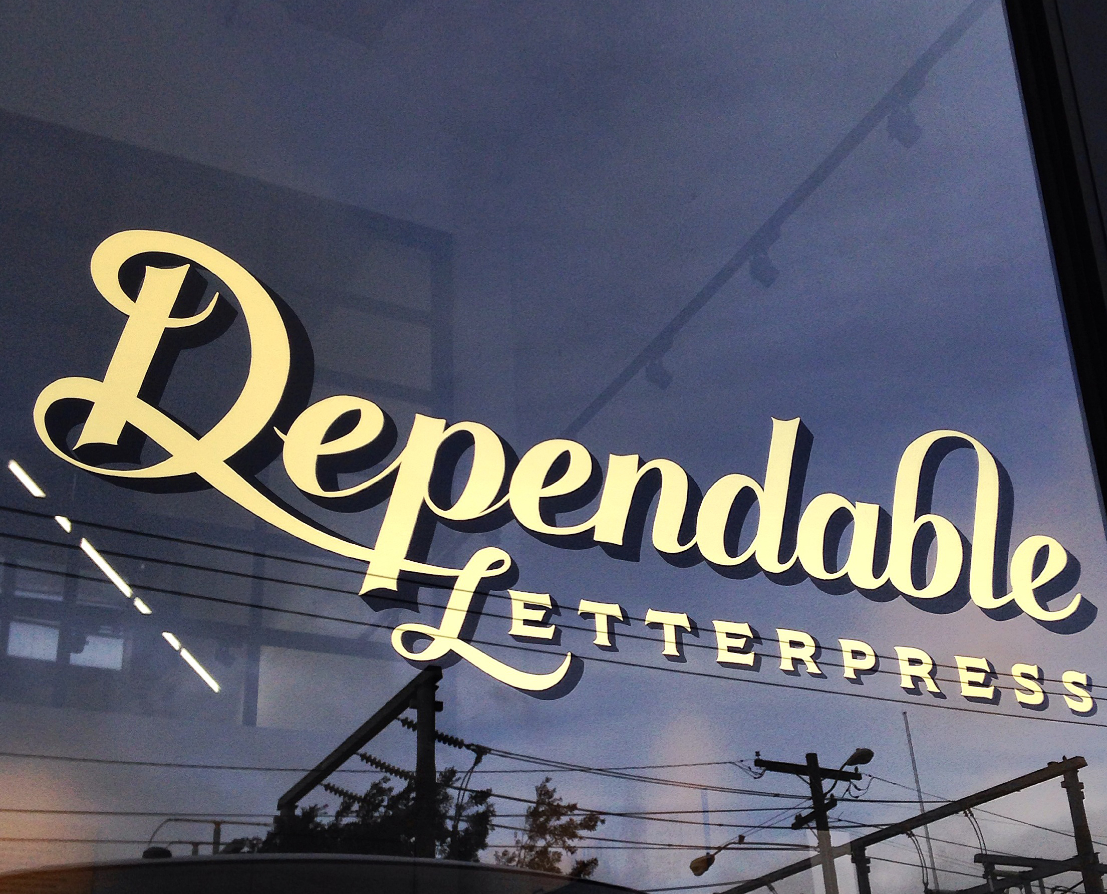 Gilded 23K gold leaf sign for the new Dependable Letterpress studio and gallery in San Francisco.