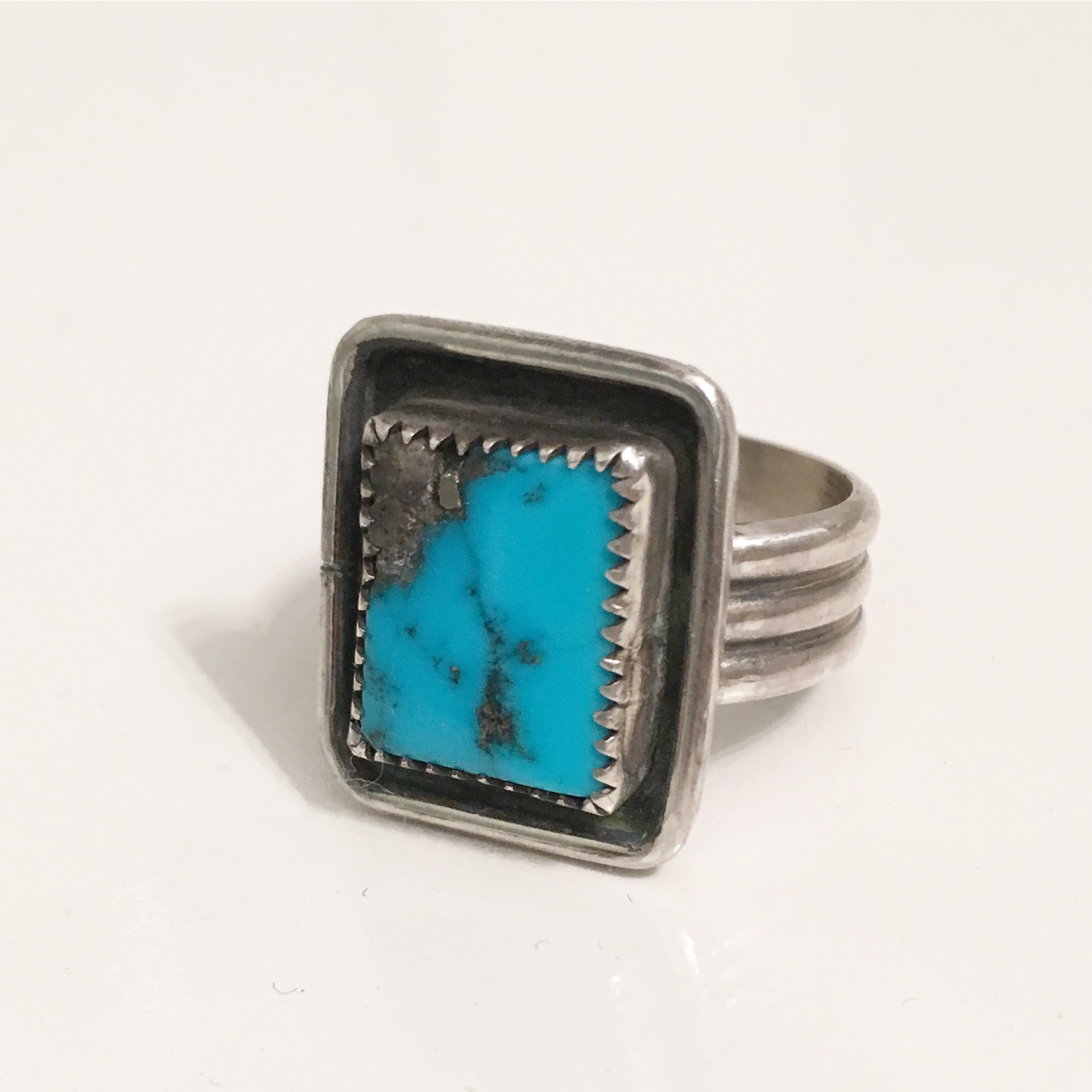 Men's turquoise ring.