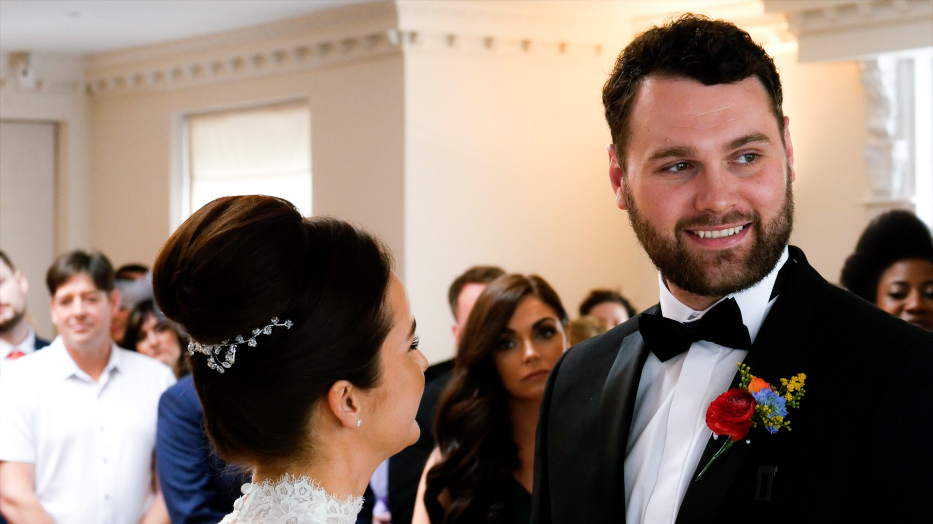 Luke smiles with great pride and joy during his wedding ceremony segment of his north west wedding video at Ashfield House.